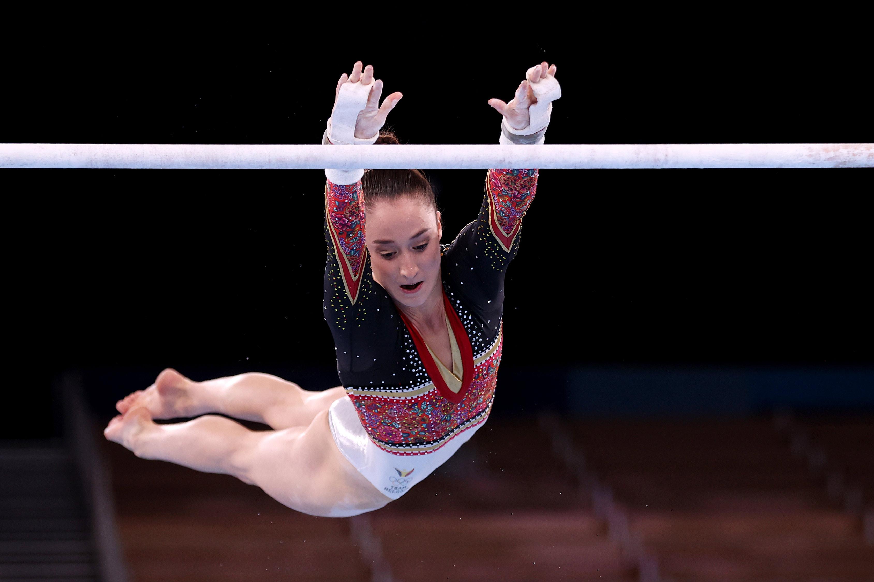 Belgium's Nina Derwael competes in the uneven bars final on August 1.
