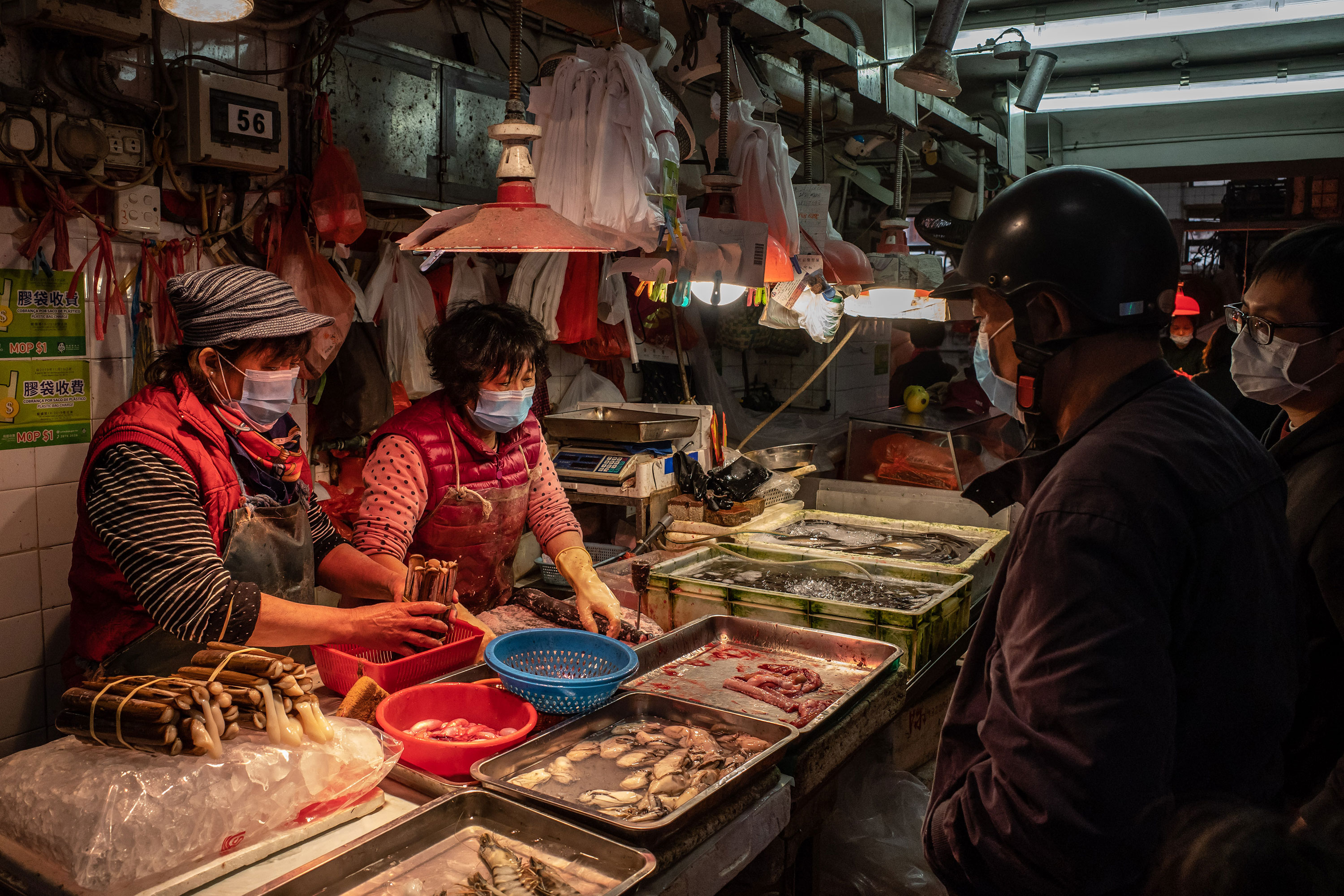 Residents purchase seafood at a wet market on January 28, in Macau, China.