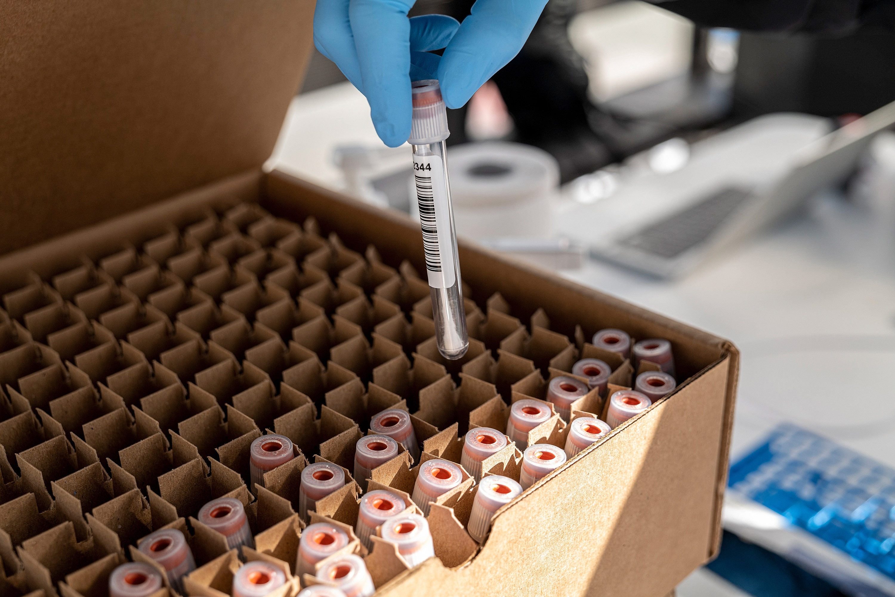 A healthcare worker places a vial containing a Covid-19 test swab into a box at a testing site in San Francisco, California, on January 9.