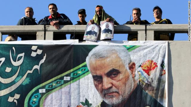 Iranian mourners stand on a bridge during the final stage of funeral processions for slain top general Qasem Soleimani, in his hometown Kerman on Jan. 7.