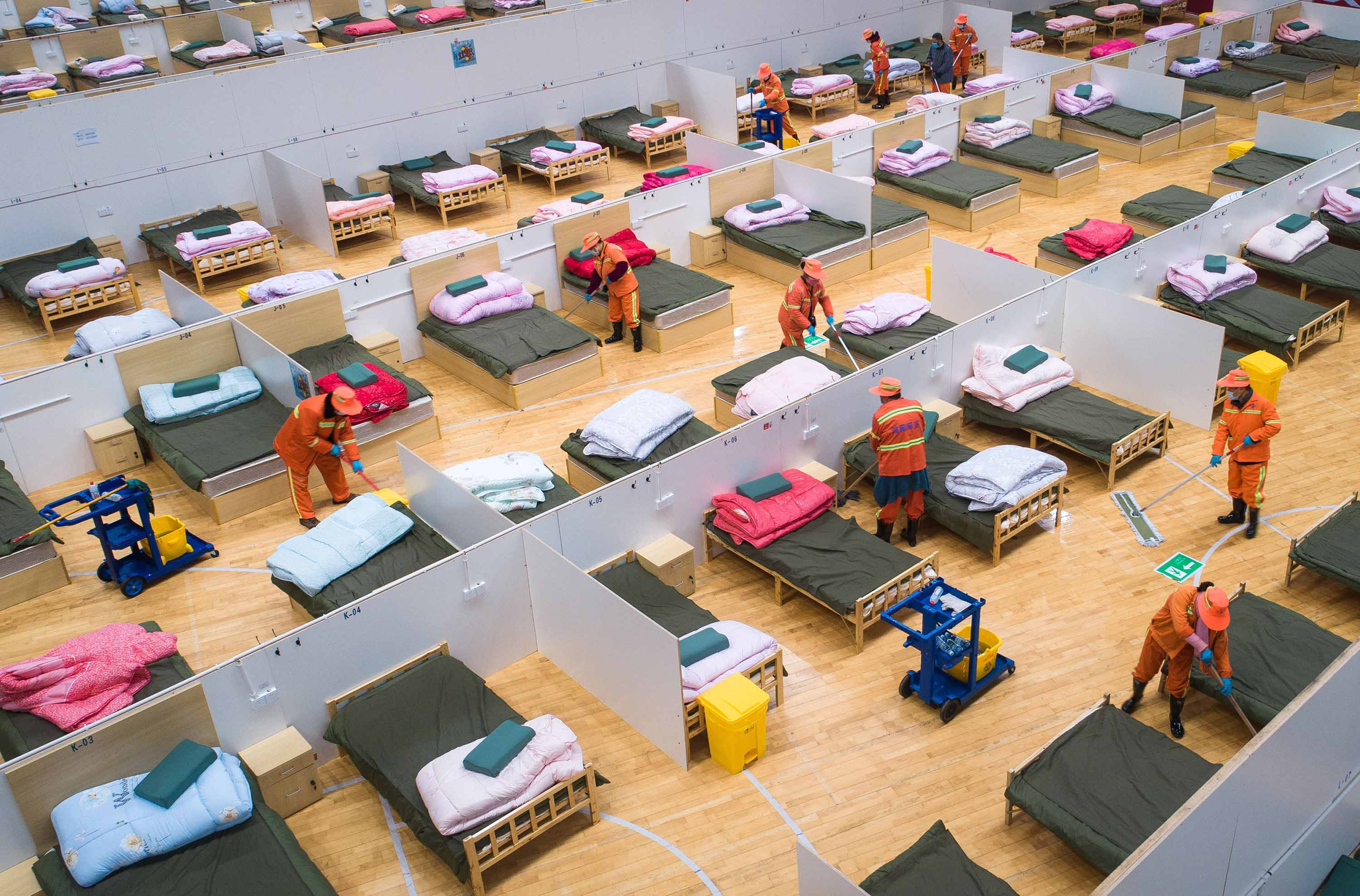 Workers prepare a temporary hospital at Wuhan Sports Center on Wednesday.