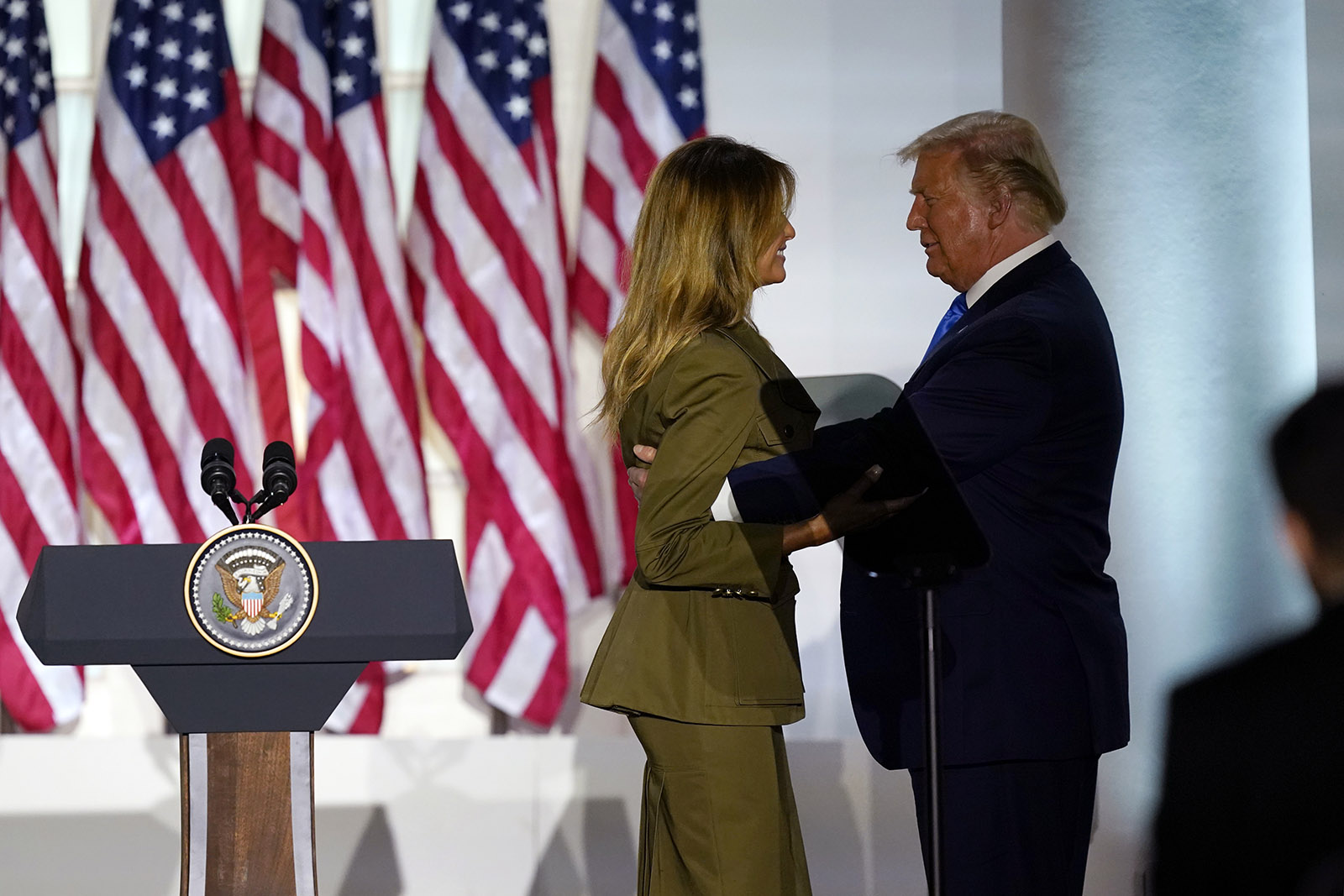 President Donald Trump joins first lady Melania Trump on stage after her speech to the 2020 Republican National Convention from the Rose Garden of the White House, on Tuesday in Washington.