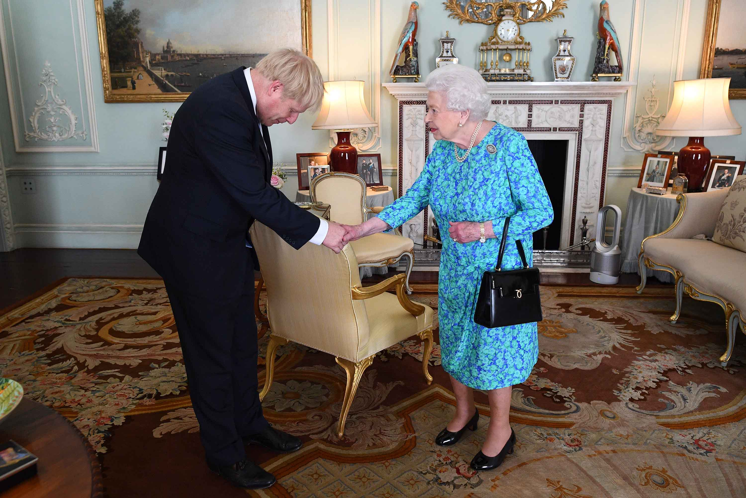 The Queen greets Boris Johnson in the Buckingham Palace.