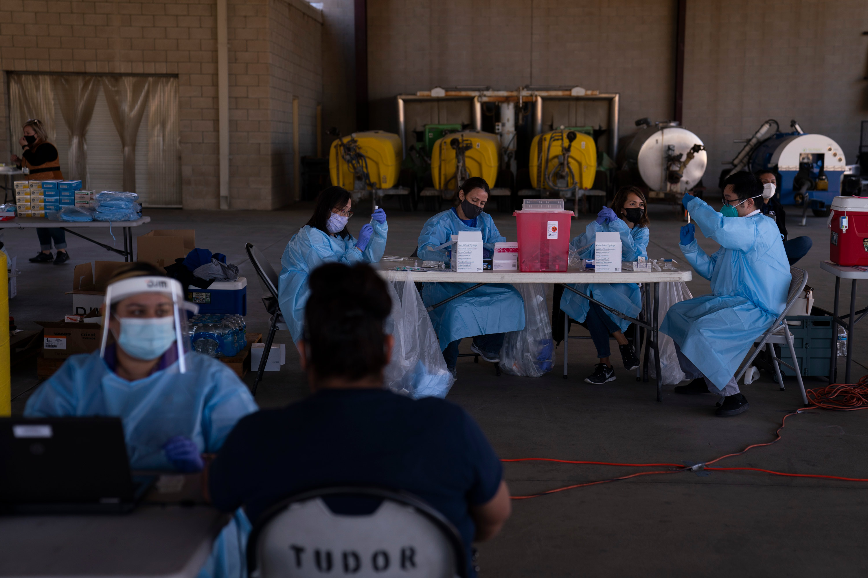 Medical workers prepare the Pfizer-BioNTech COVID-19 vaccine in Mecca, California, on January 21.