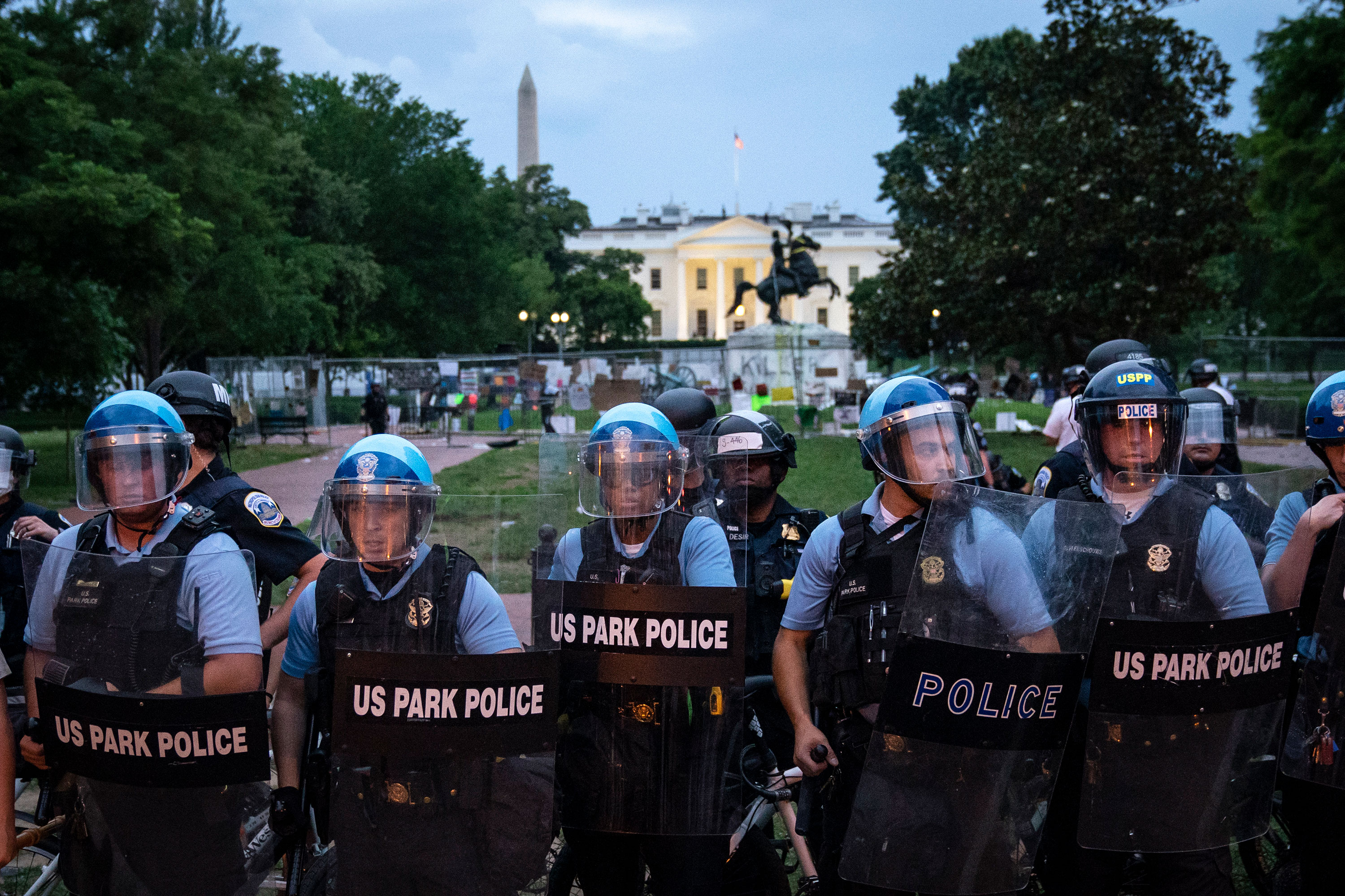 U.S. Park Police keep protesters back after they attempted to pull down the statue of Andrew Jackson in Lafayette Square near the White House on June 22 in Washington.