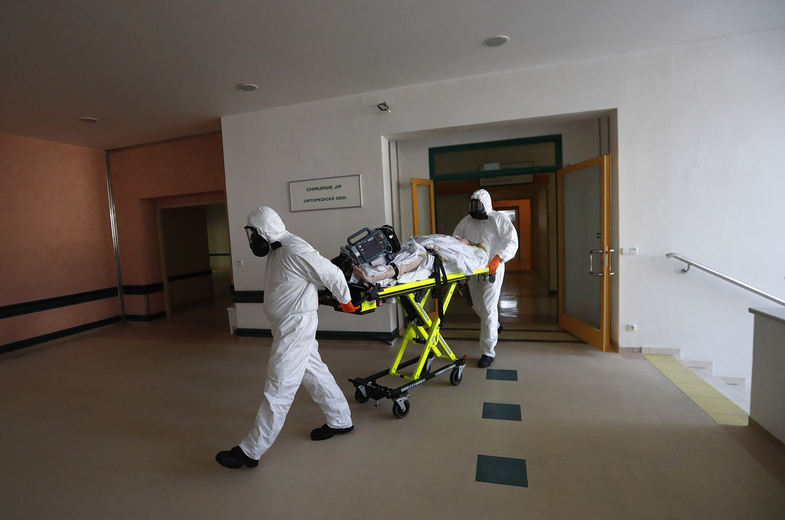 Healthcare workers transport a Covid-19 patient from an intensive care unit at a hospital in Kyjov to a hospital in Brno, Czech Republic on October 22.