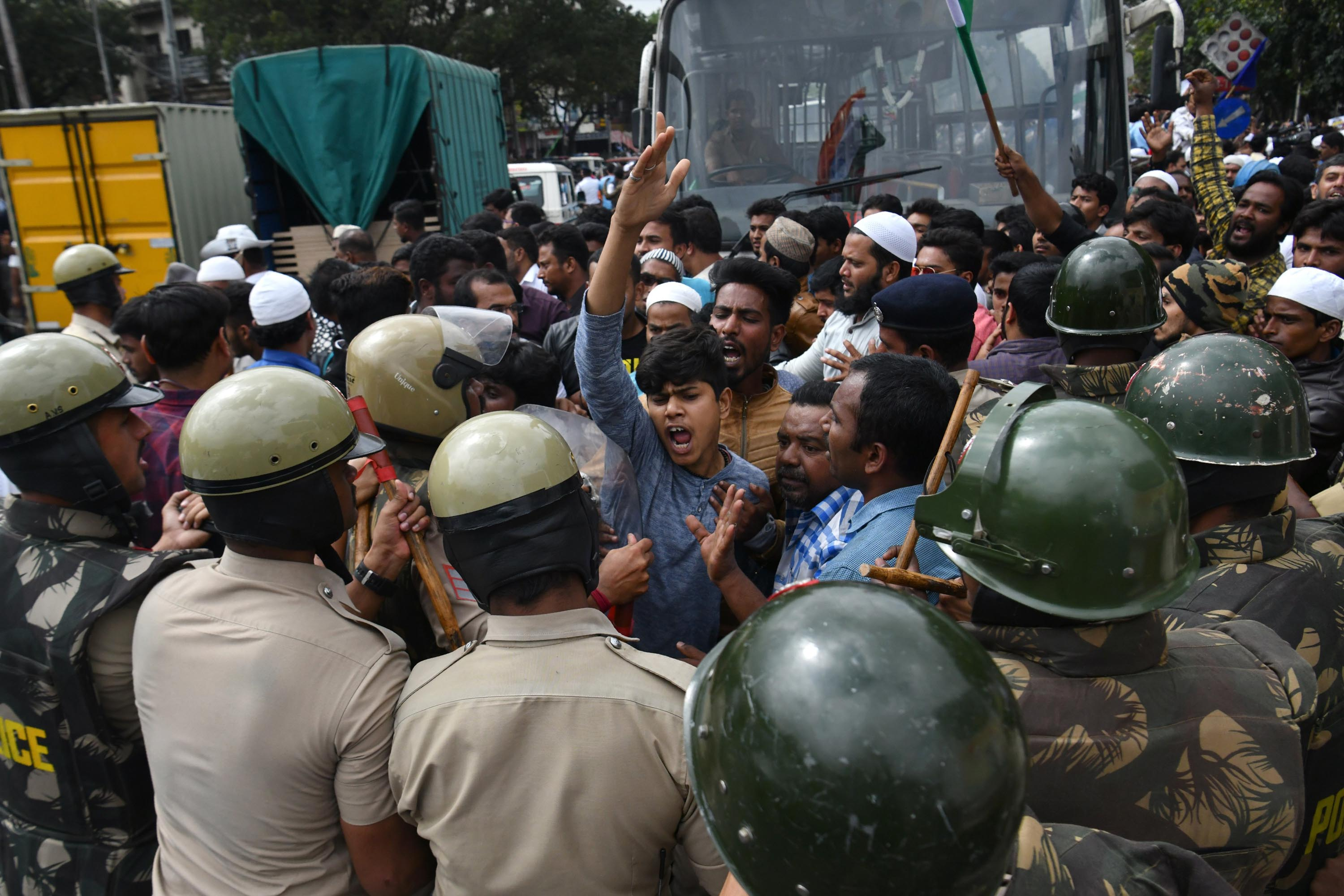 Police and protesters clash in Bangalore. Photo: Manjunath Kiran/AFP via Getty Images