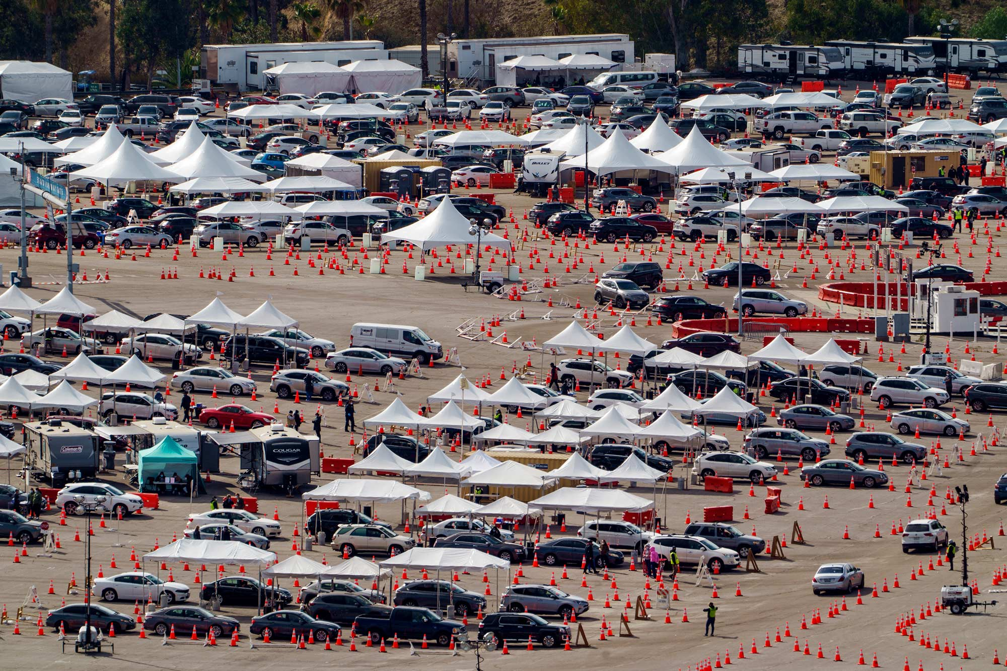Drivers wait in line at a mega COVID-19 vaccination site set up in the parking lot of Dodger Stadium in Los Angeles on January 27.