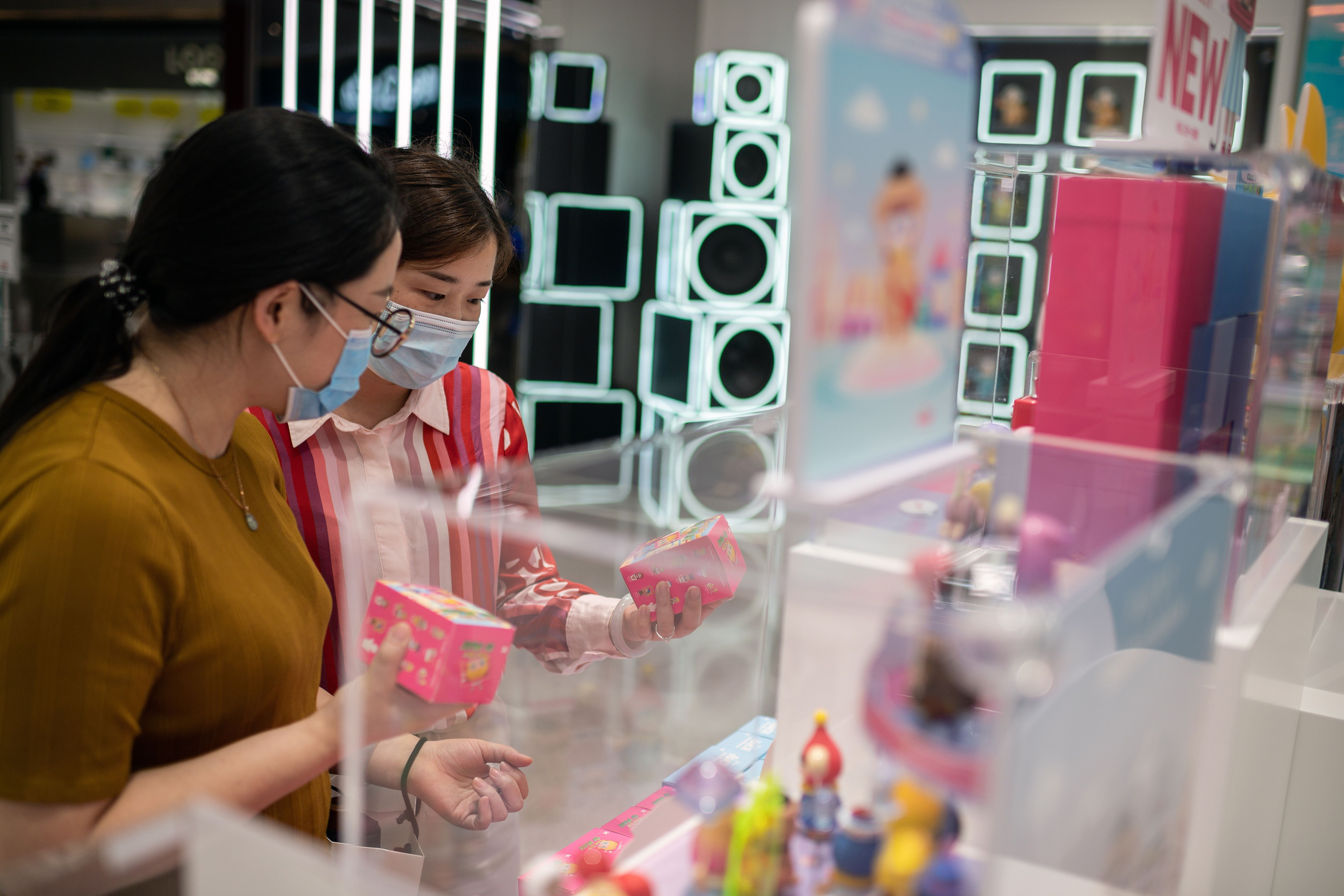 People in Beijing look at products in a toy shop on September 15.