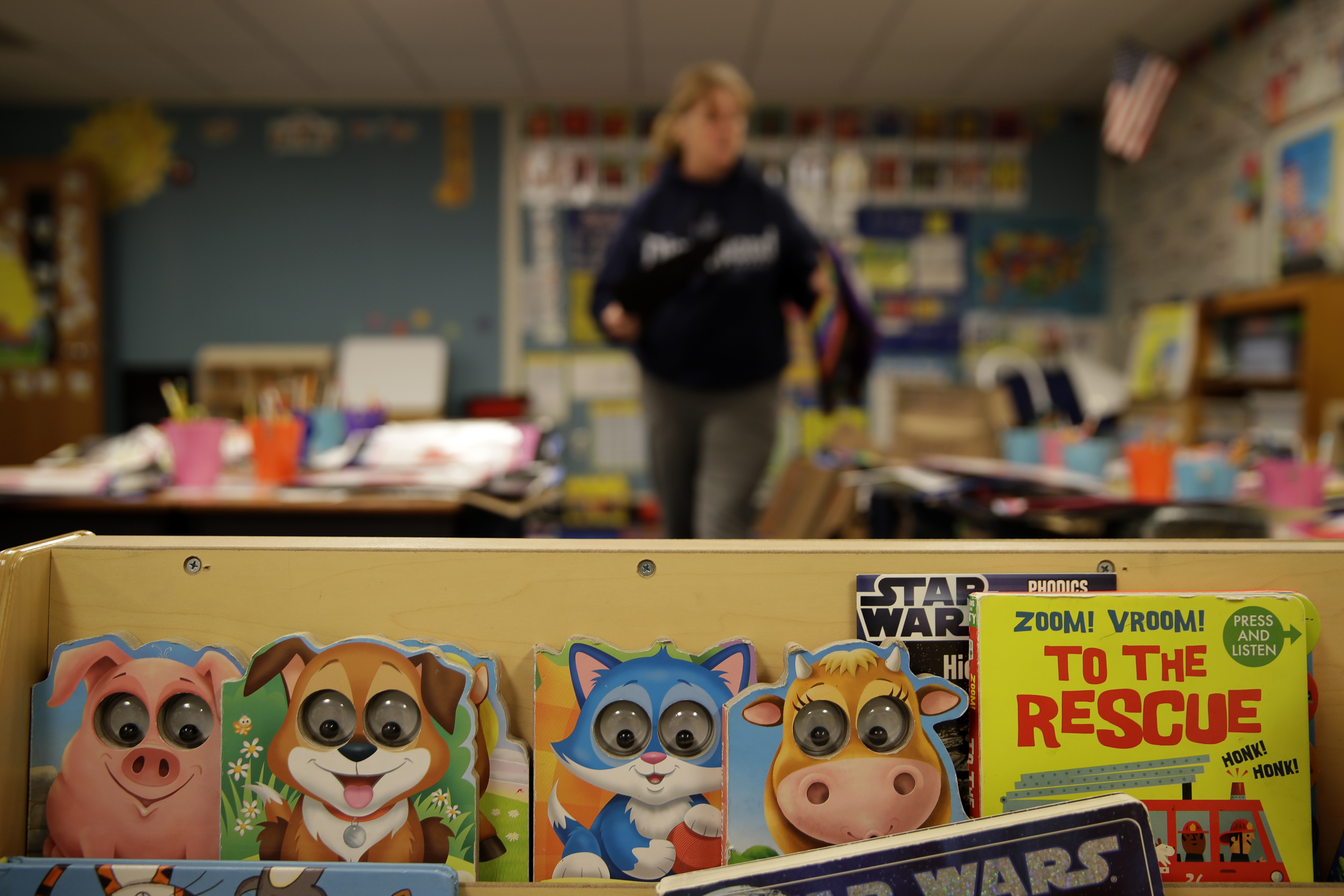 Jill Evans sorts students' belongings in her kindergarten classroom at Walnut Grove Elementary School in Olathe, Kansas, on May 12. The school closed on March 13, as all Kansas schools were ordered shut to help prevent the spread of the coronavirus and eventually ordered closed for the rest of the school year.