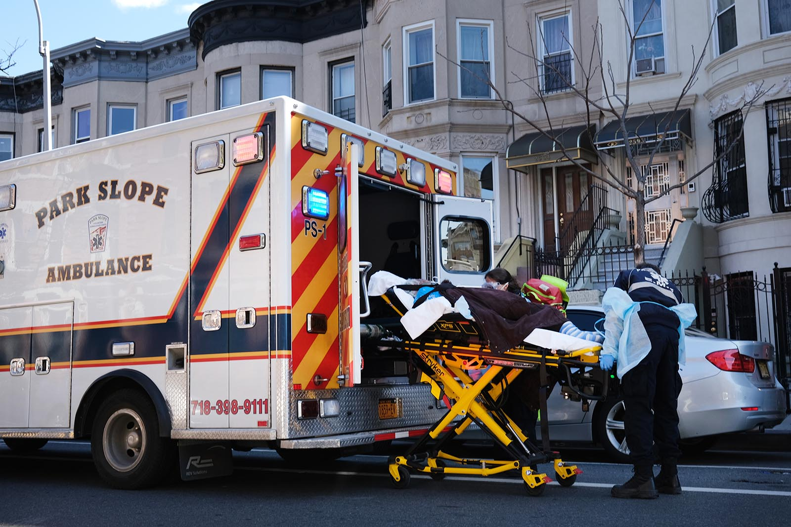 Health workers carry a patient to an ambulance on April 11, 2020 in the Brooklyn borough of New York City.