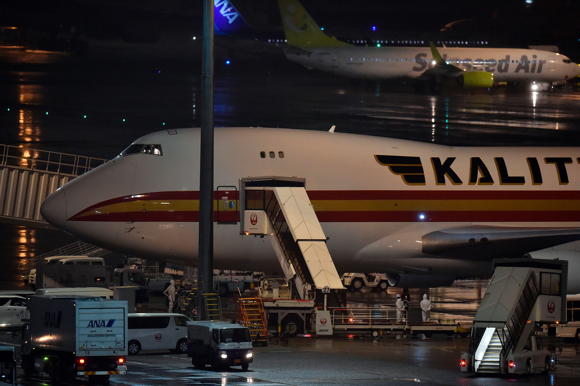 Jumbo jets arrived to evacuate US citizens from the Diamond Princess cruise ship, with people quarantined onboard due to fears of the new COVID-19 coronavirus, at the Haneda airport in Tokyo on February 16.