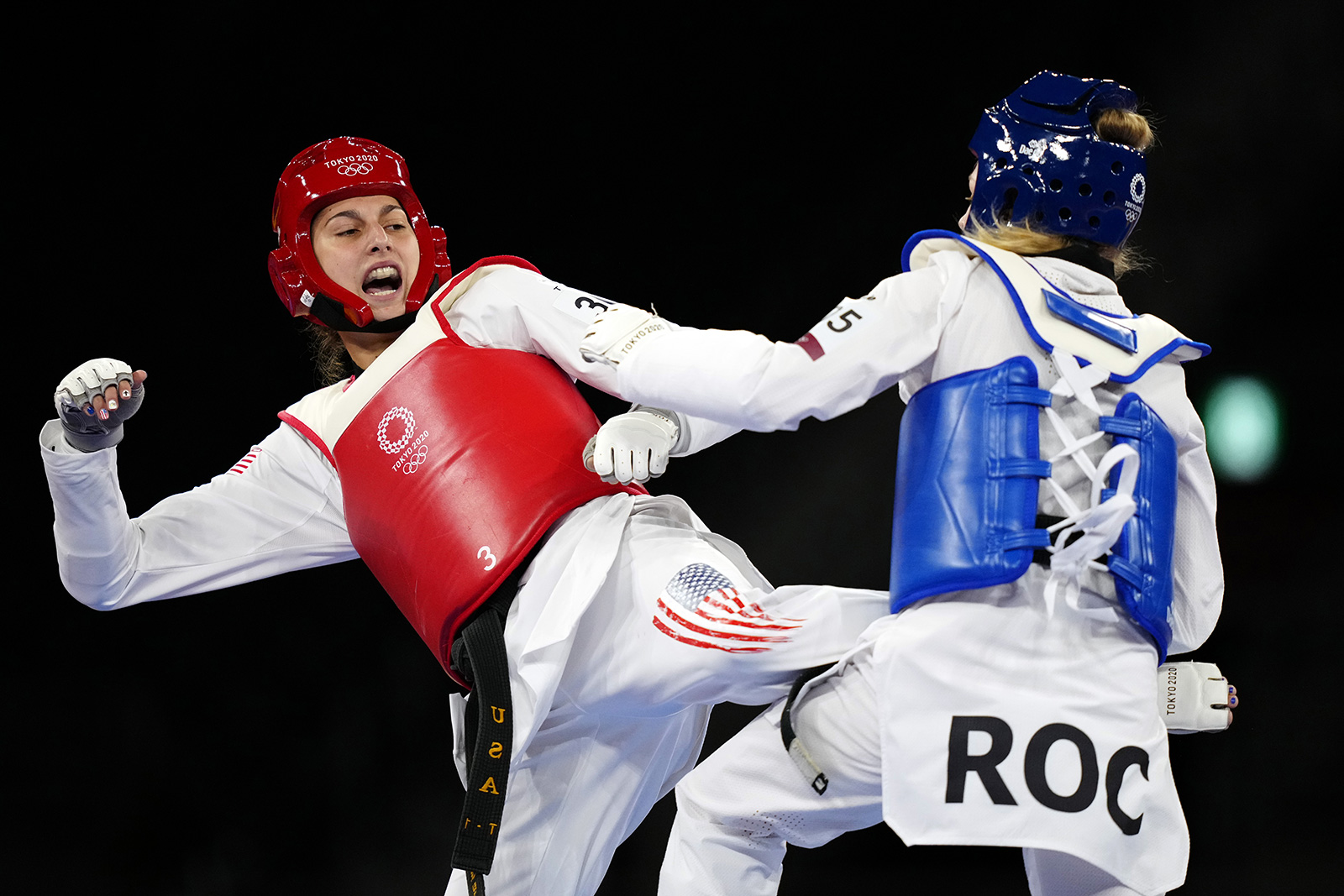 Anastasija Zolotic of the United States competes in a Taekwondo contest against Tatiana Manina of the Russian Olympic Committee on July 25.