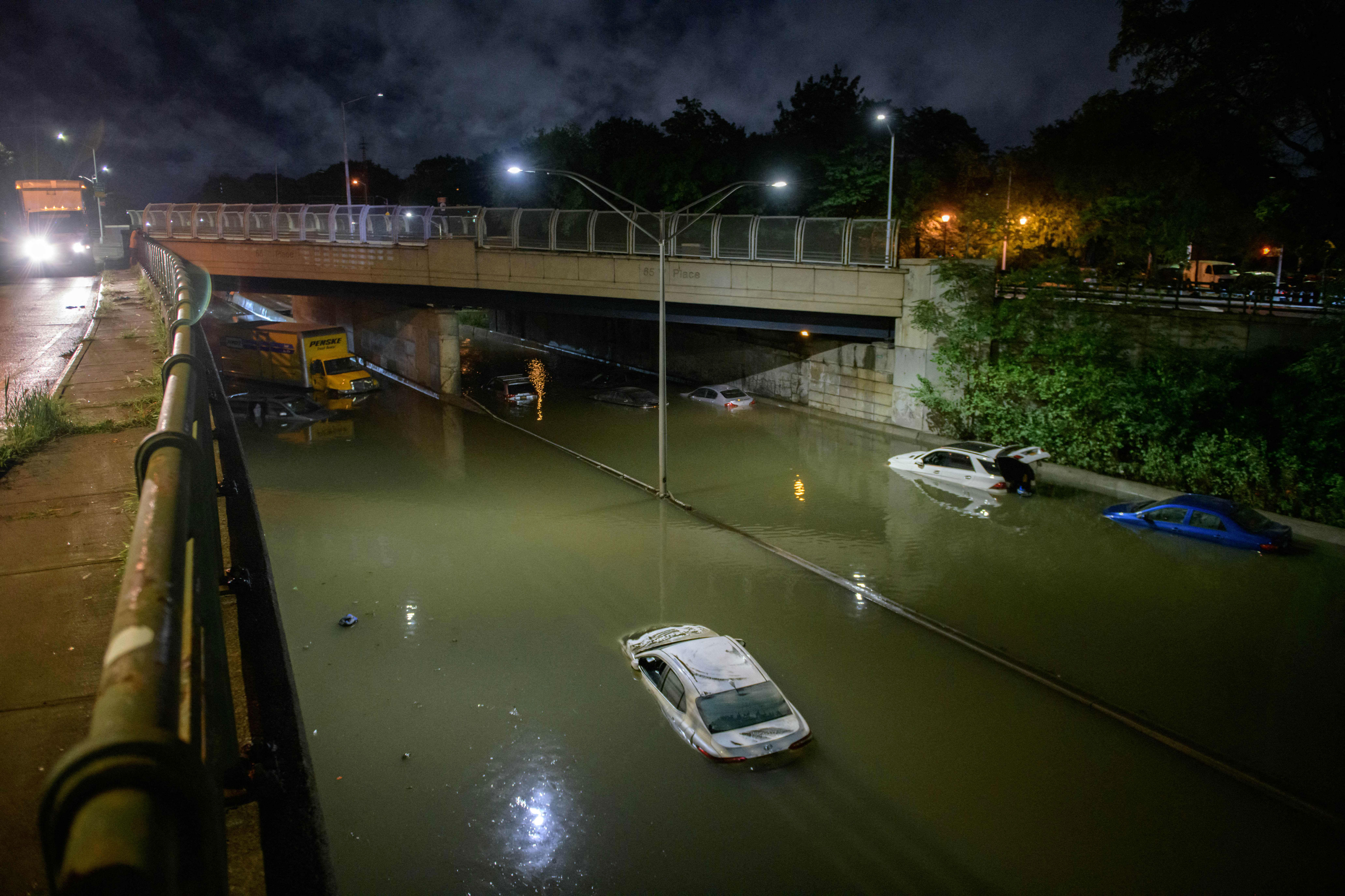Vehicles are in floodwaters on an expressway in Brooklyn, New York, on September 2.