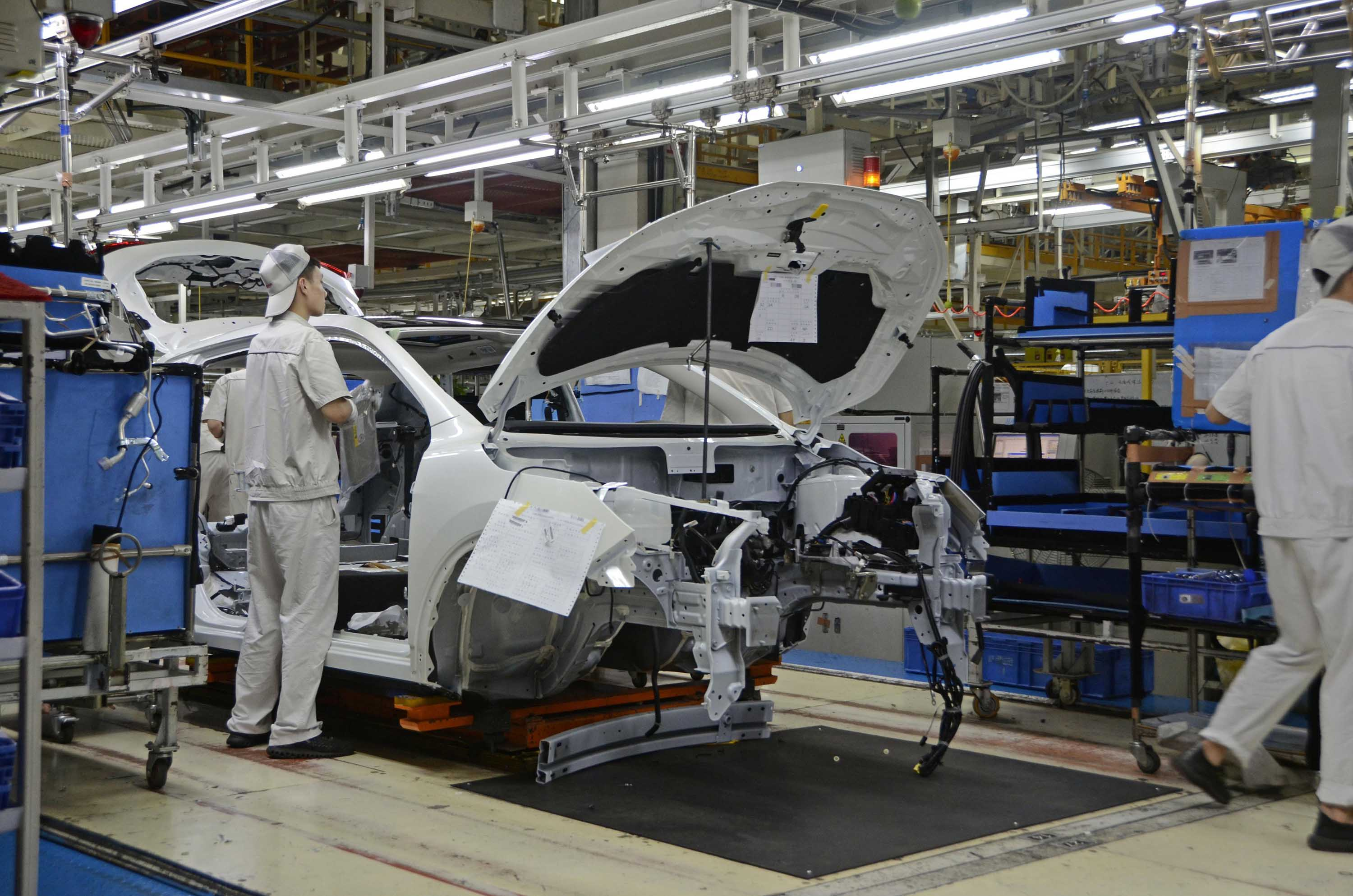 A Nissan auto assembly line is pictured at a plant in Dalian, China in July 2019.