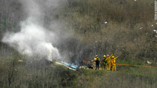 Firefighters work the scene of a helicopter crash where NBA legend Kobe Bryant died Sunday, January 26, 2020, in Calabasas, California.
