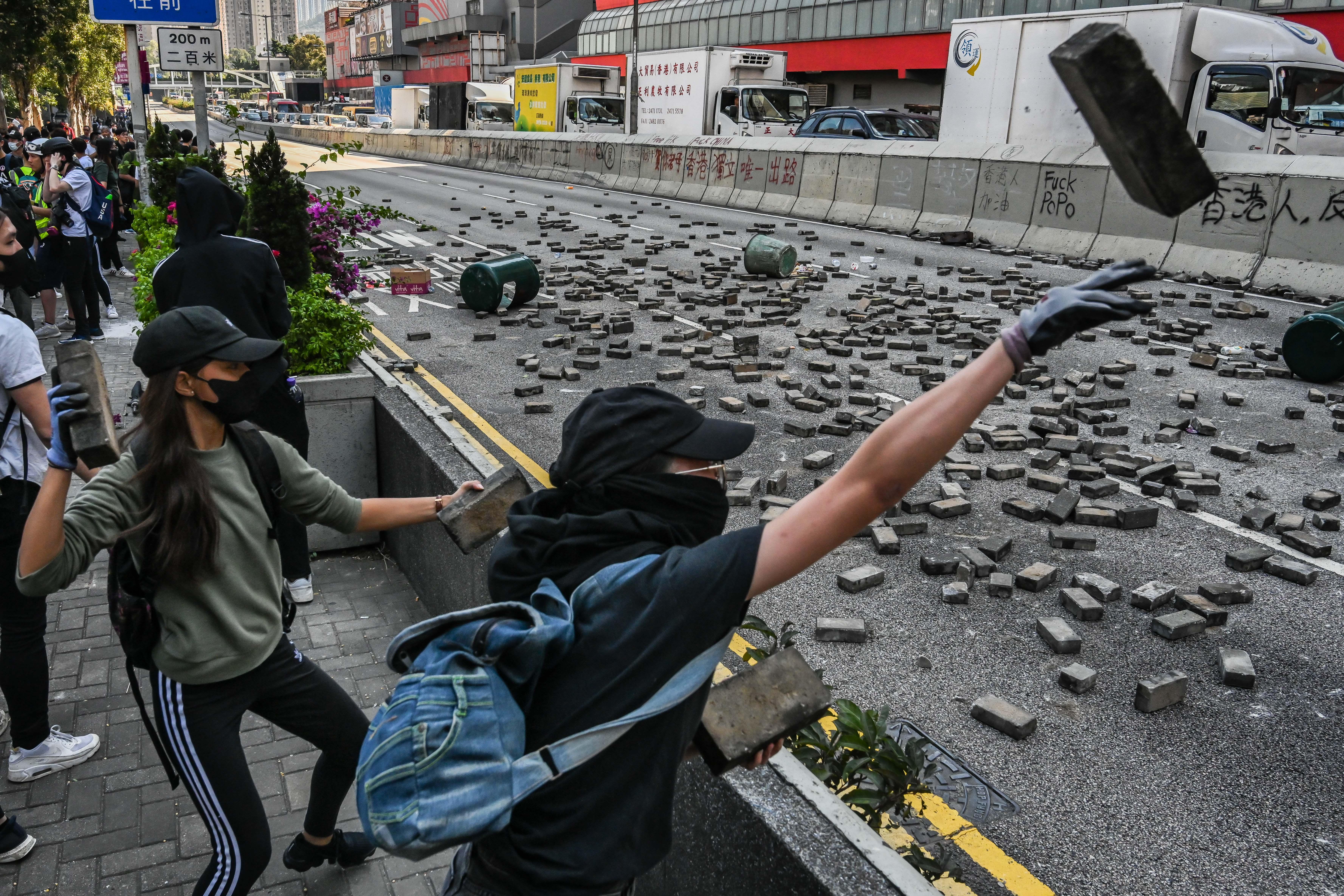 Protestors throw bricks to the road in Wong Tai Sin district on November 11, 2019 in Hong Kong.
