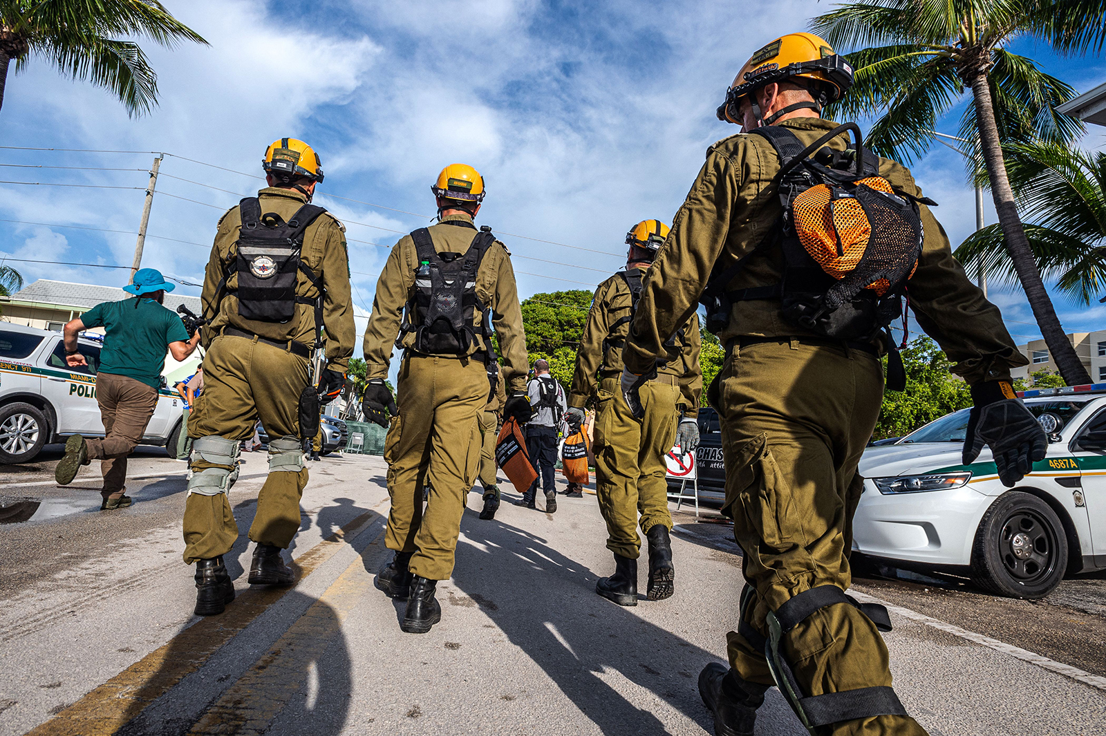 Members of the Israel Rescuers delegation gather upon their arrival in the area near the partially collapsed 12-story Champlain Towers South condo building in the city of Surfside, Florida, on June 27.