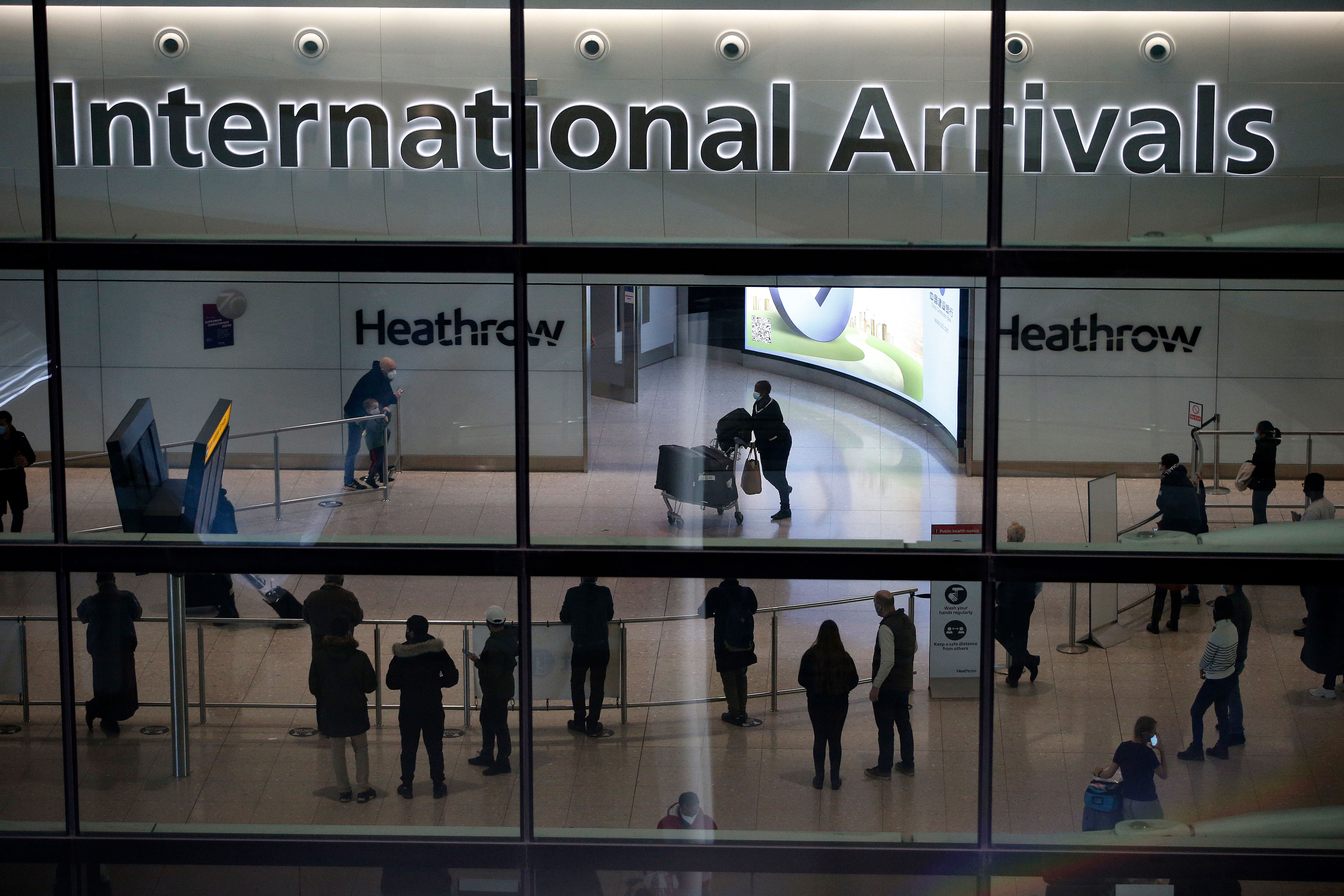People are at Heathrow Airport in London on January 17.