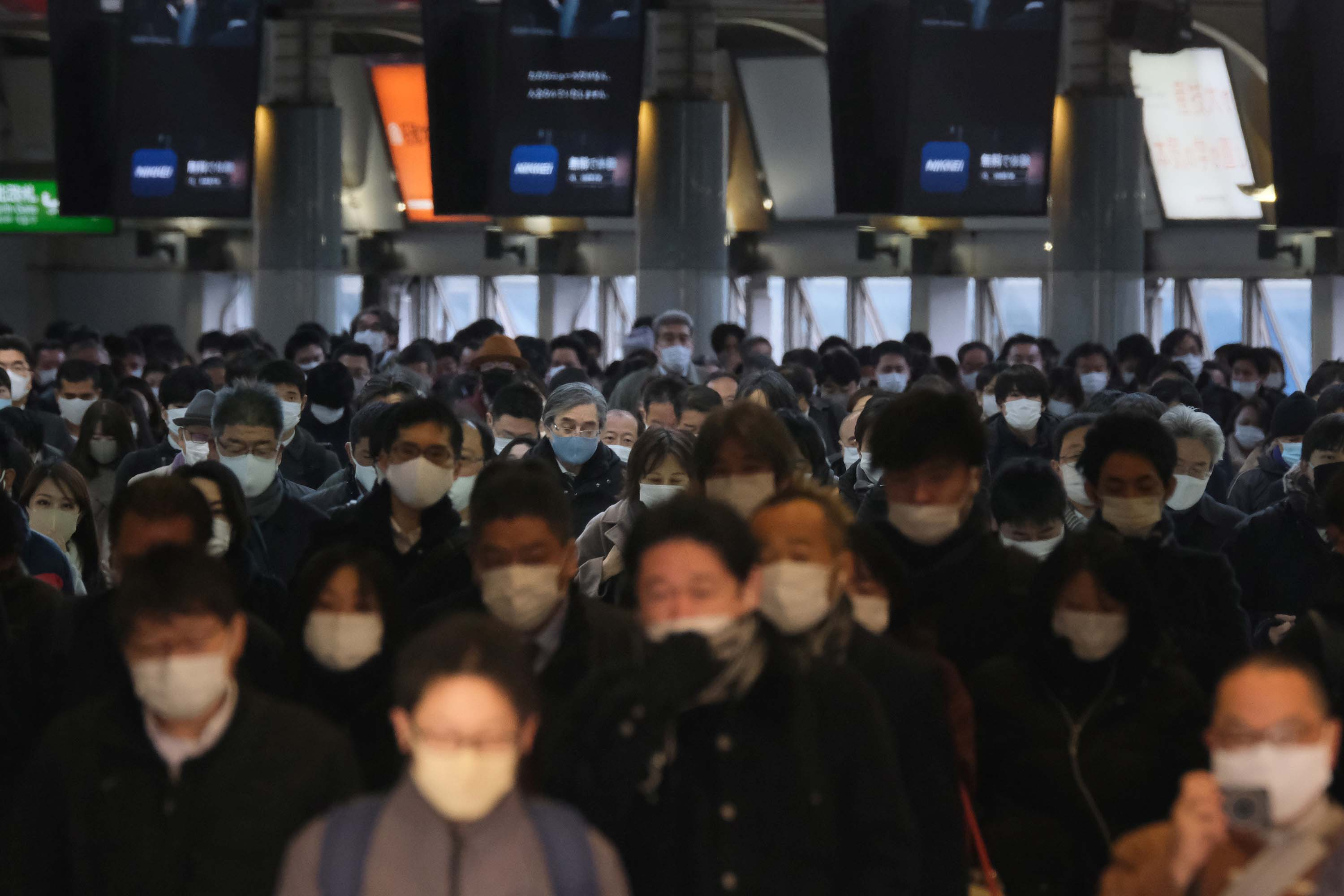 Commuters wear face masks as they make their way through Shinagawa Station in Tokyo, Japan, on January 8.