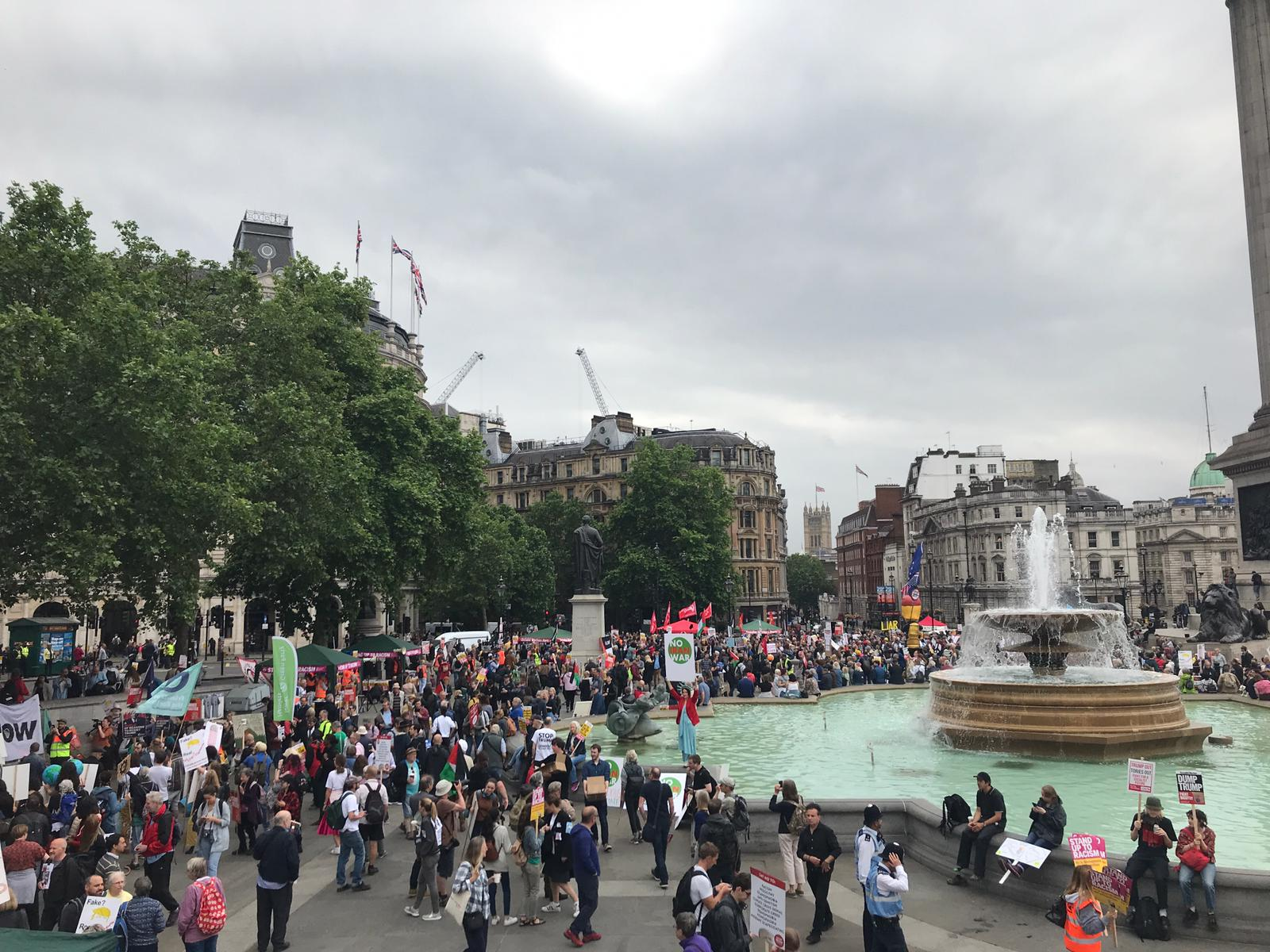 Protesters start to assemble in Trafalgar Square.