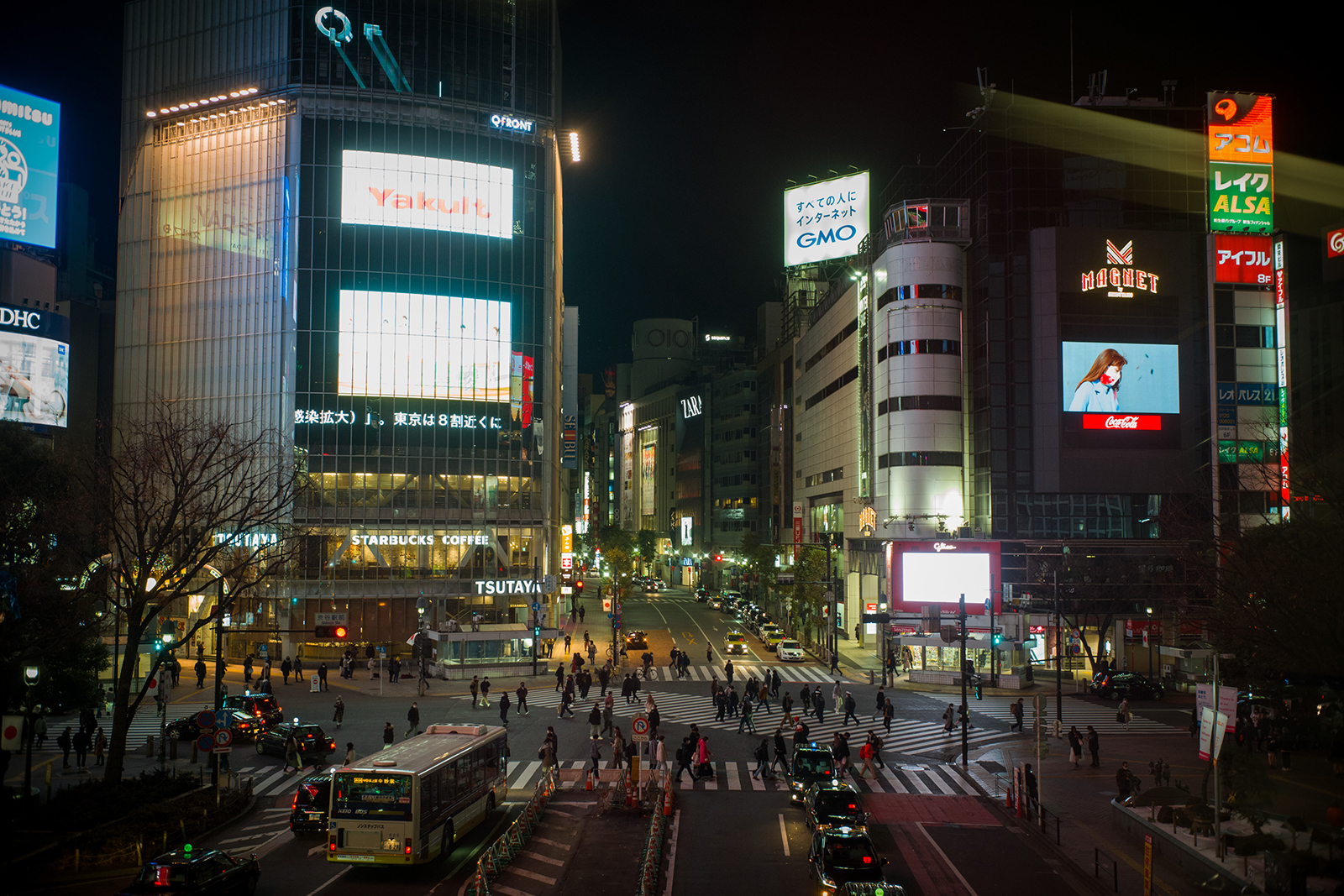 Pedestrians cross an intersection in the Shibuya district of Tokyo, on January 8.