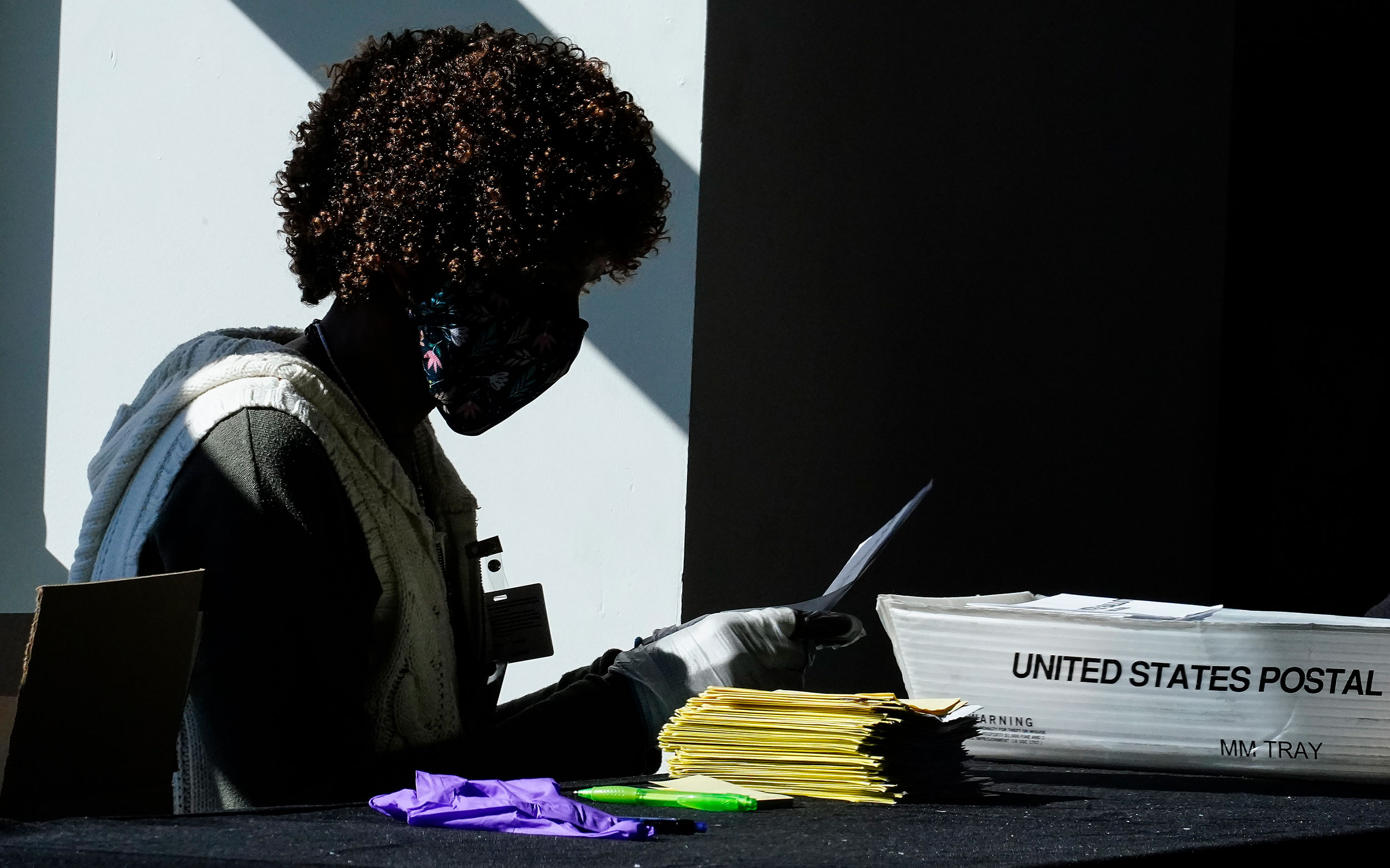 An election worker counts ballots at State Farm Arena on Wednesday, November 4 in Atlanta.