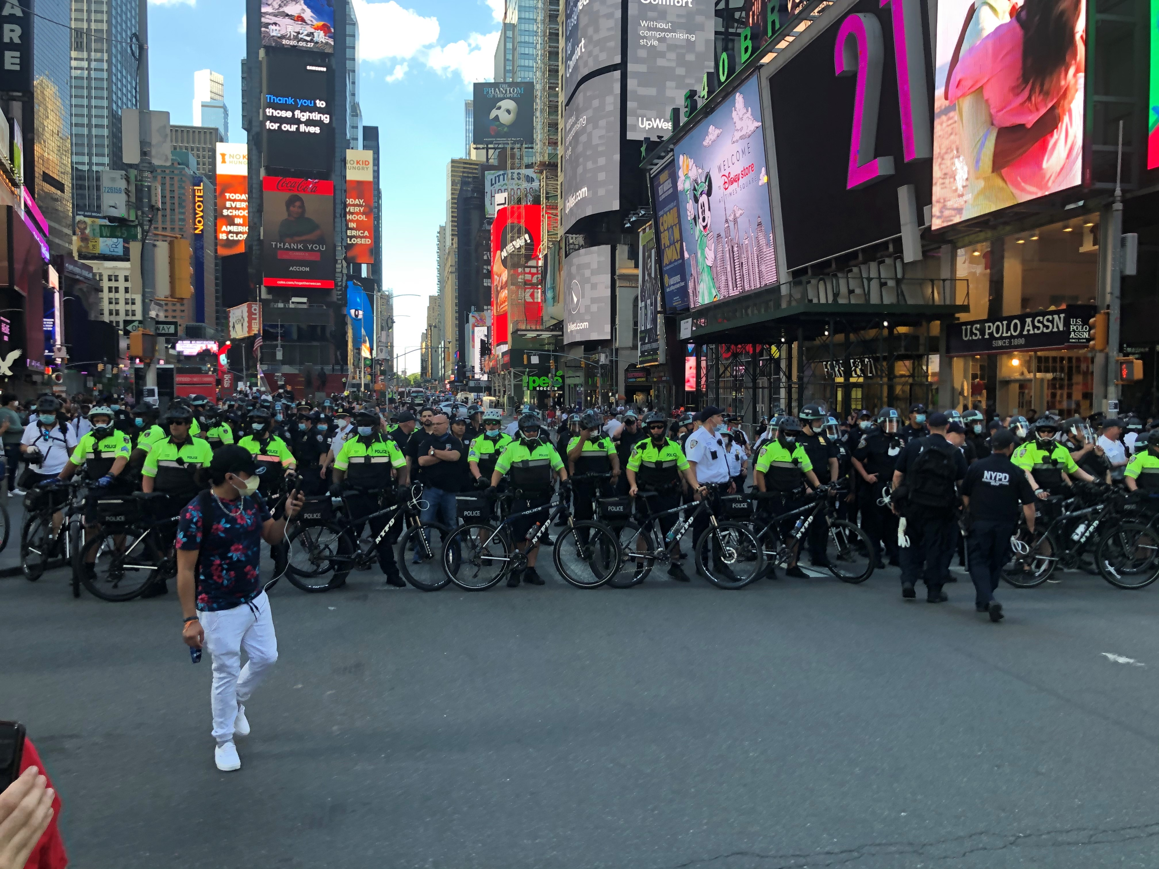 New York police officers form a line in Times Square on May 30, 2020.