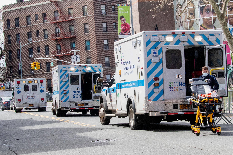 Ambulances line the street outside Elmhurst Hospital Center in Queens, New York on April 4.