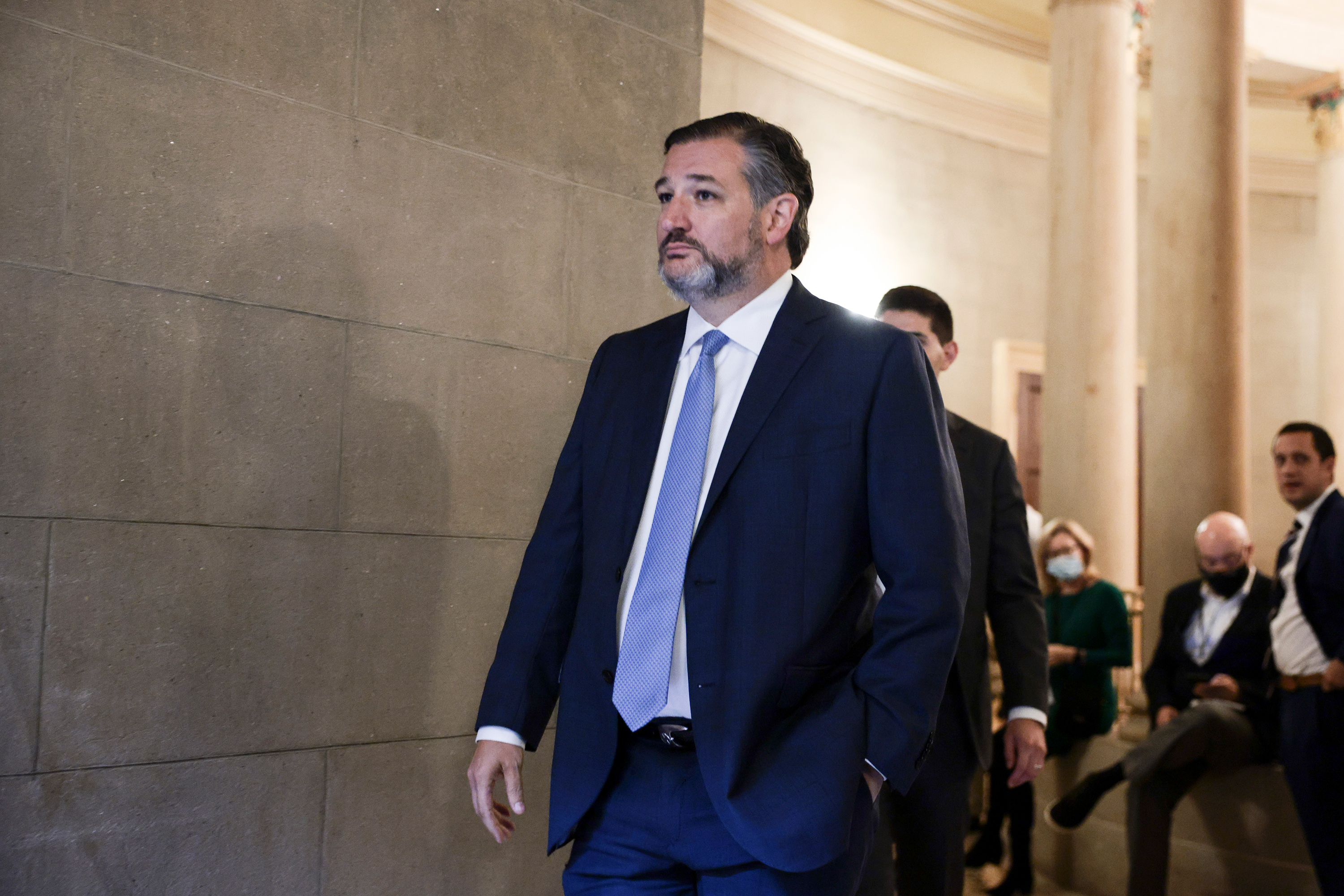 Sen. Ted Cruz arrives to a meeting with Republican Senators on their party's plan for the vote on the debt limit on October 7.
