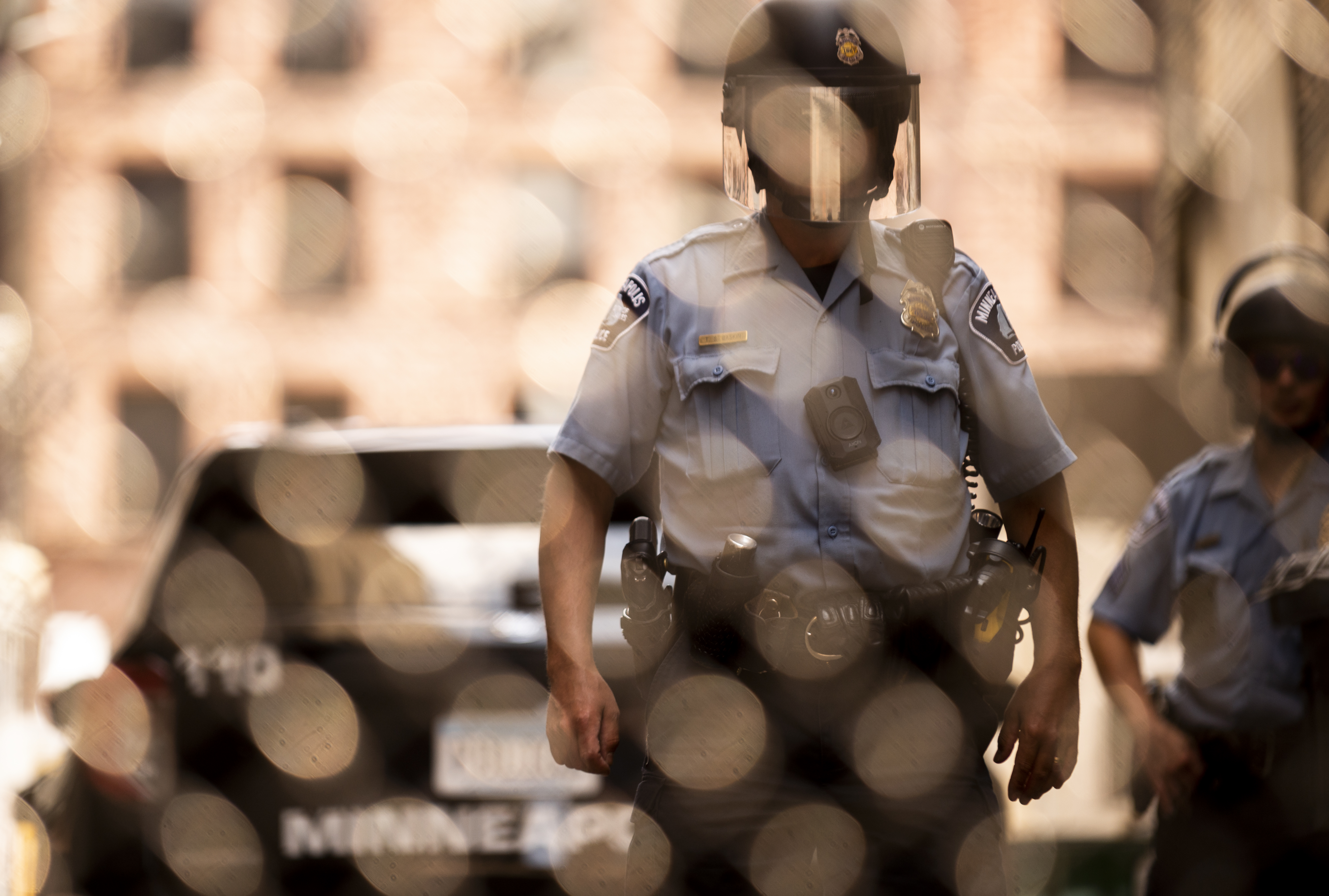 Members of the Minneapolis Police Department seen through a chain link gate on June 13, in Minneapolis, Minnesota.