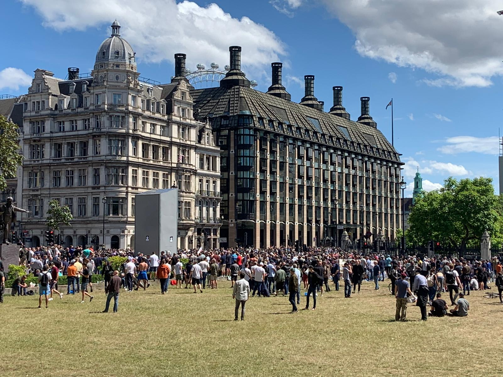 Protesters gathered in Parliament Square, London, on Saturday, where statues including one of Winston Churchill are boarded up.
