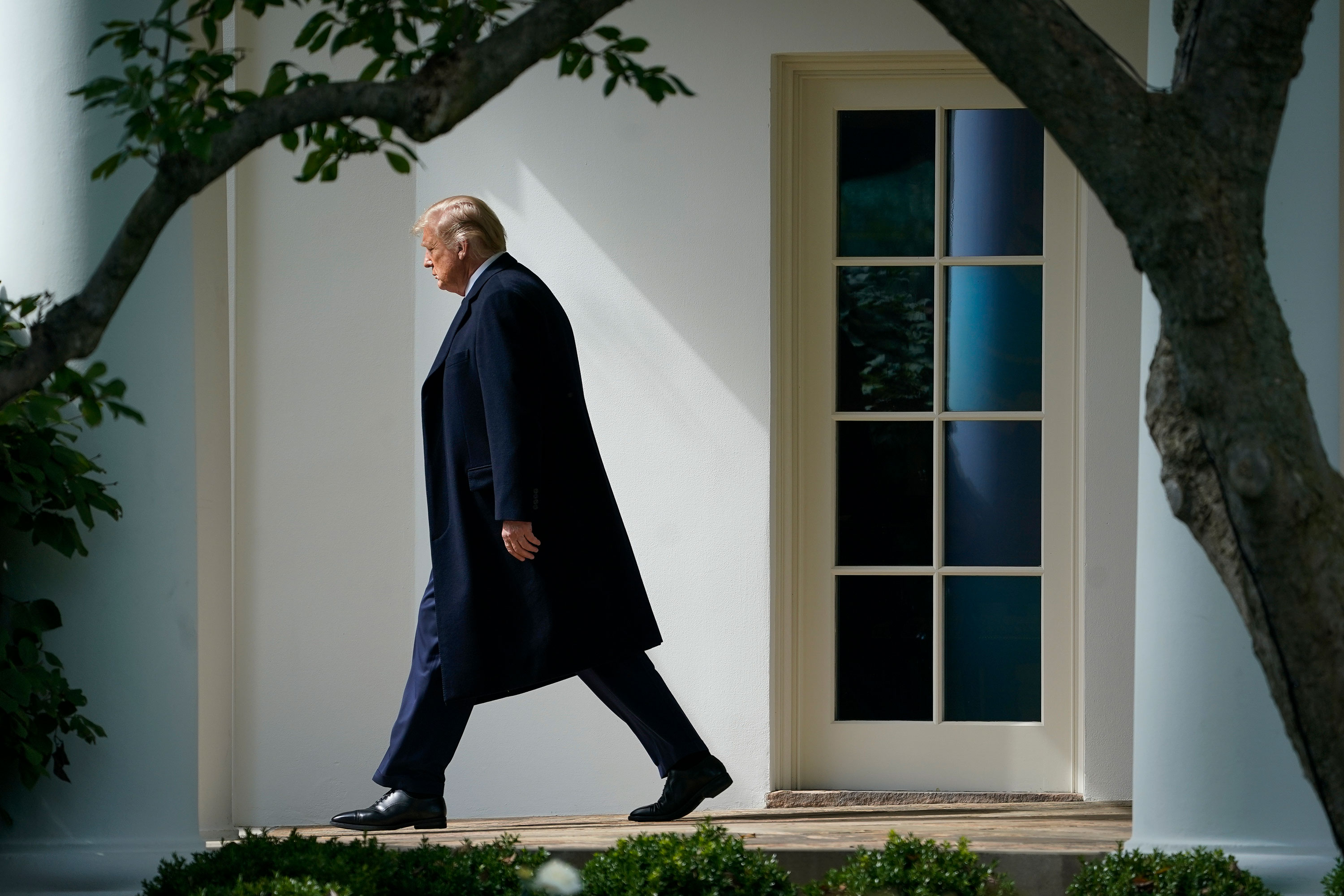 President Donald Trump exits the Oval Office and walks to Marine One on the South Lawn of the White House on October 1. President Trump was traveling to Bedminster, New Jersey, for a roundtable event with supporters and a fundraiser.