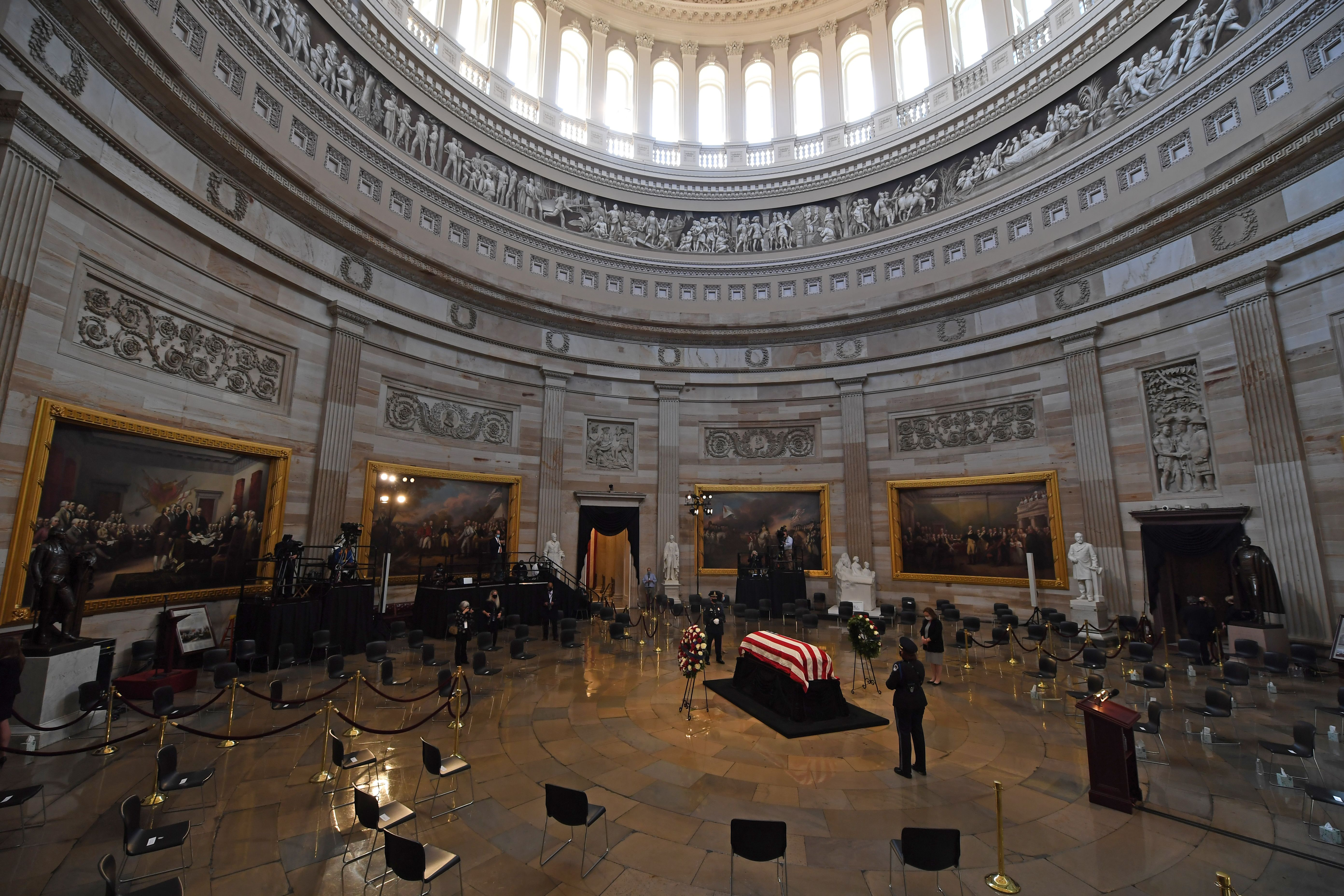 People pay their respects to the late Rep. John Lewis as he lies in state at the Capitol Rotunda in Washington, DC.