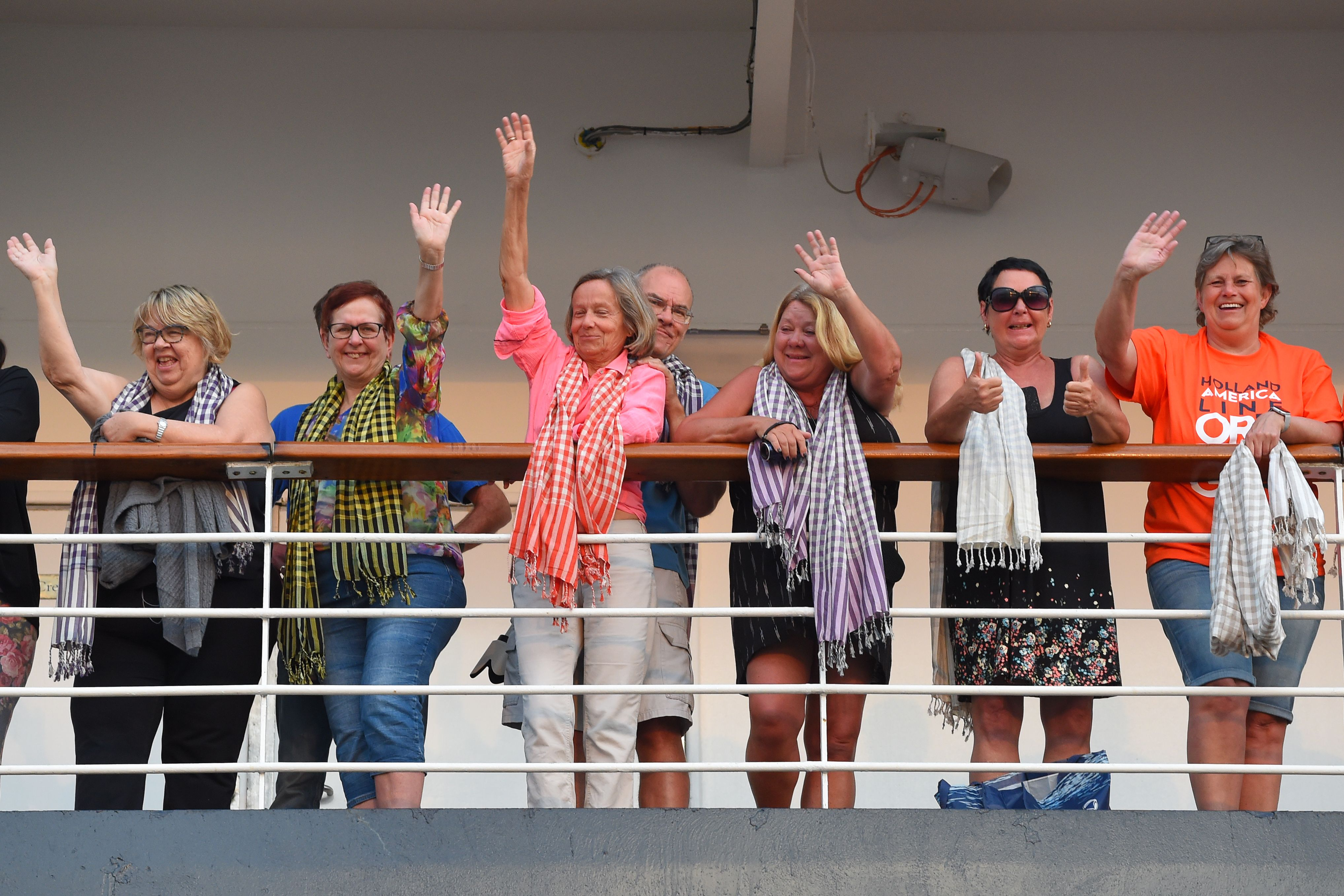 Passengers on board the Westerdam cruise ship wave in Sihanoukville, Cambodia on February 14.