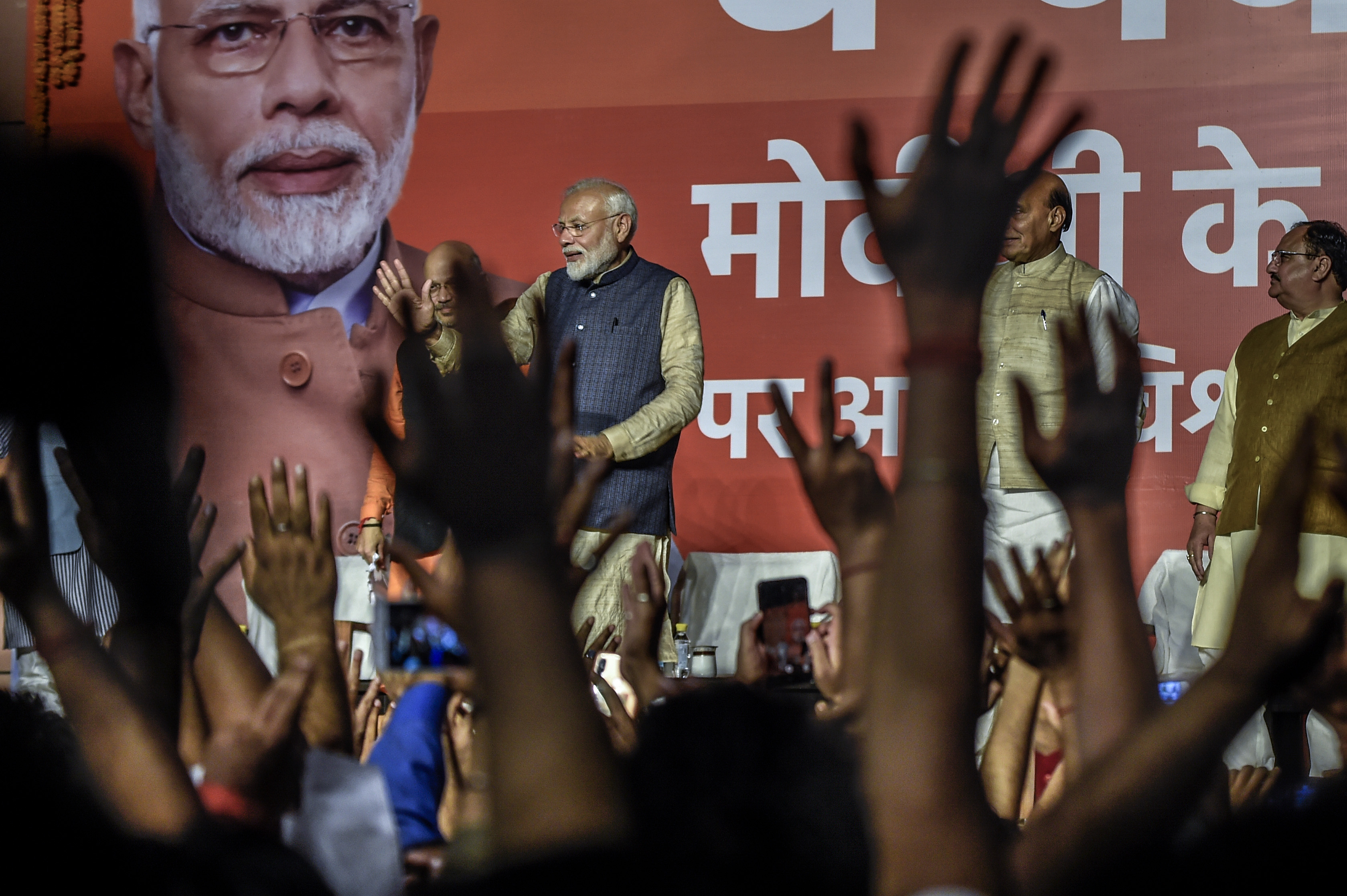 Indian Prime Minister Narendra Modi talks to party workers at Bharatiya Janata Party's headquarters in New Delhi, India.