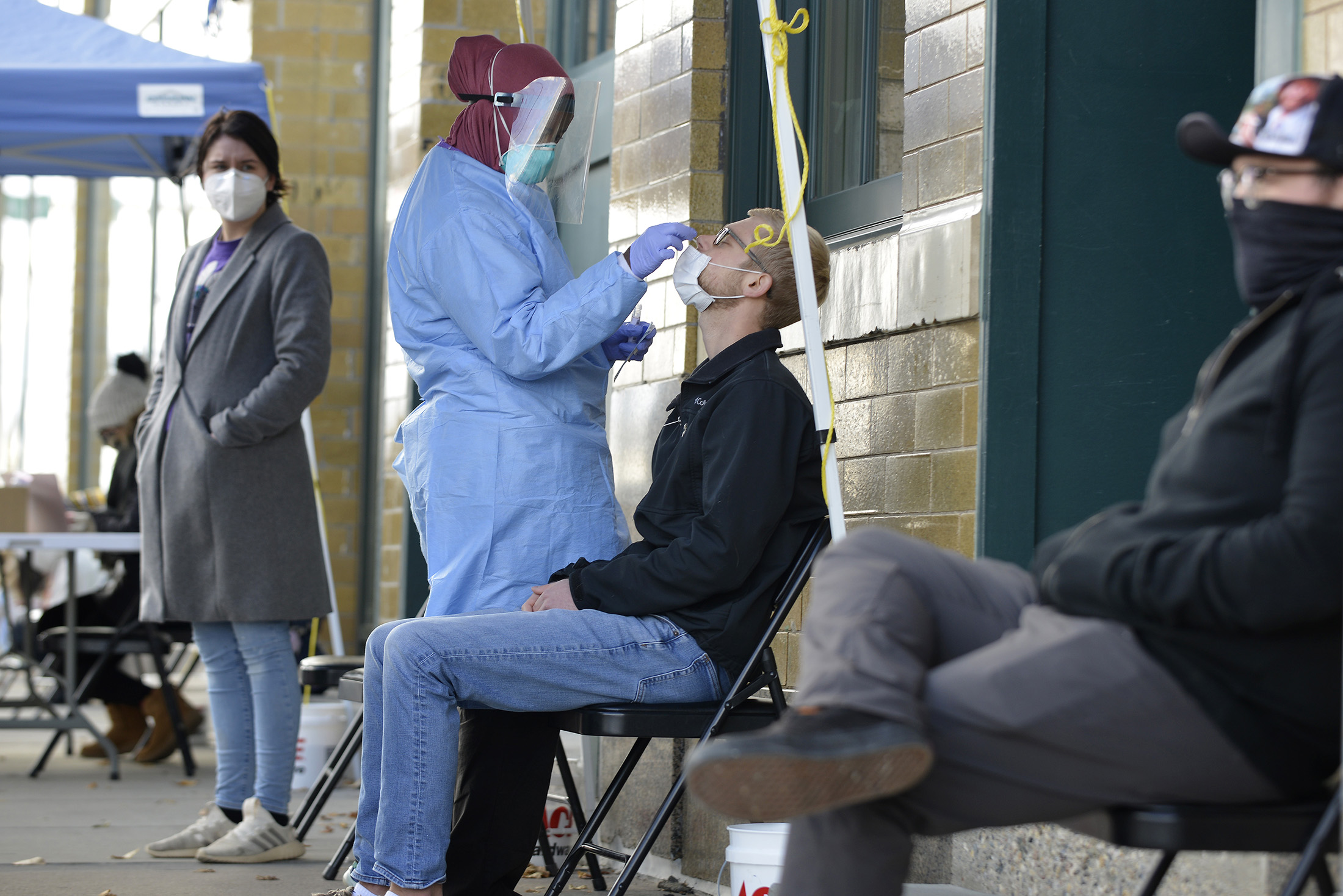 A medical staff member performs a Covid-19 test in Fargo, North Dakota, on Thursday, October 15, 2020.