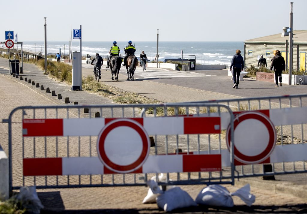 Police on horseback patrol on the boulevard along the beach in Zandvoort on April 4, amid the outbreak of Covid-19