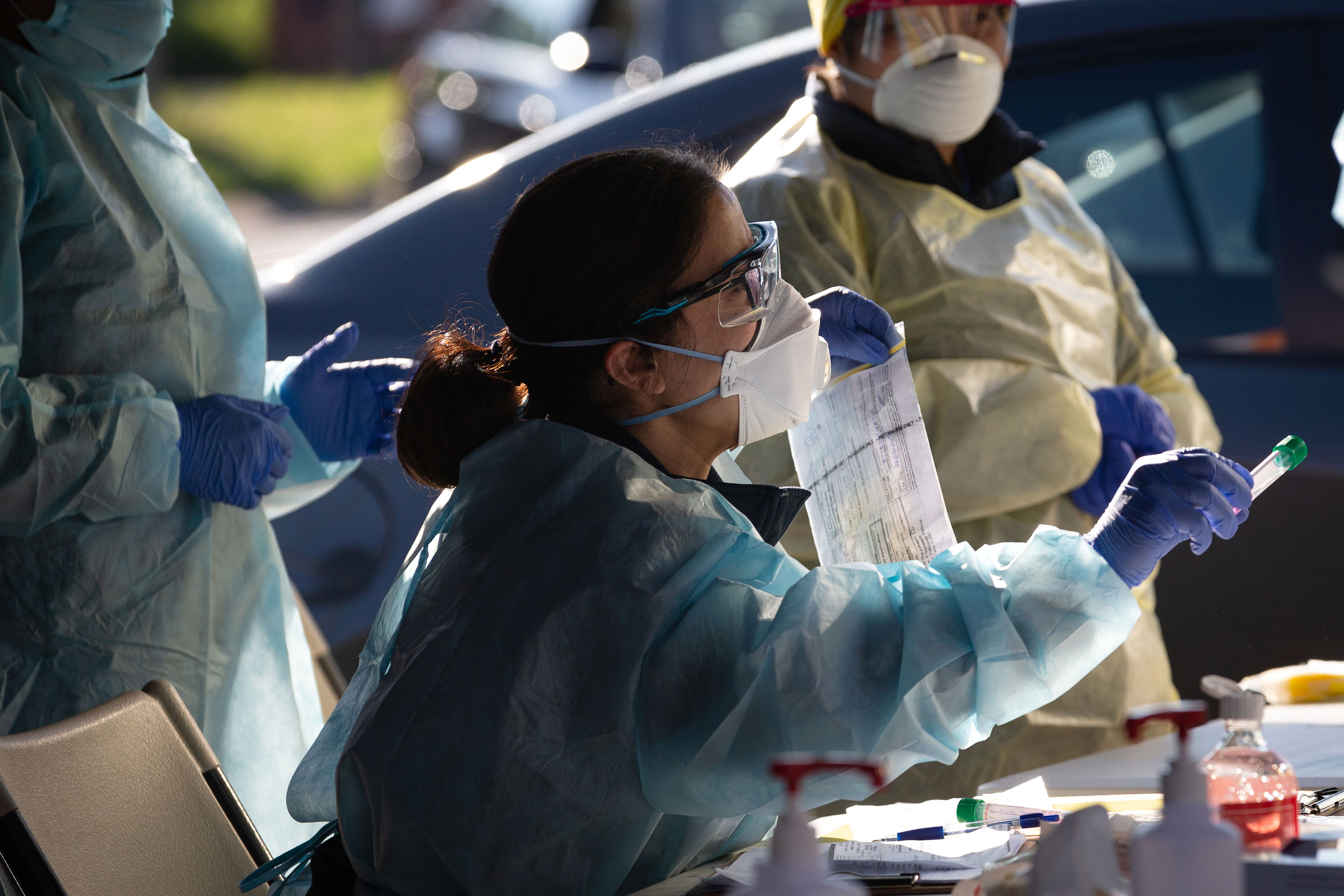 A member of the Covid-19 testing team holds a vile with a swab from a test conducted at a pop-up testing facility on June 28 in Melbourne, Australia.