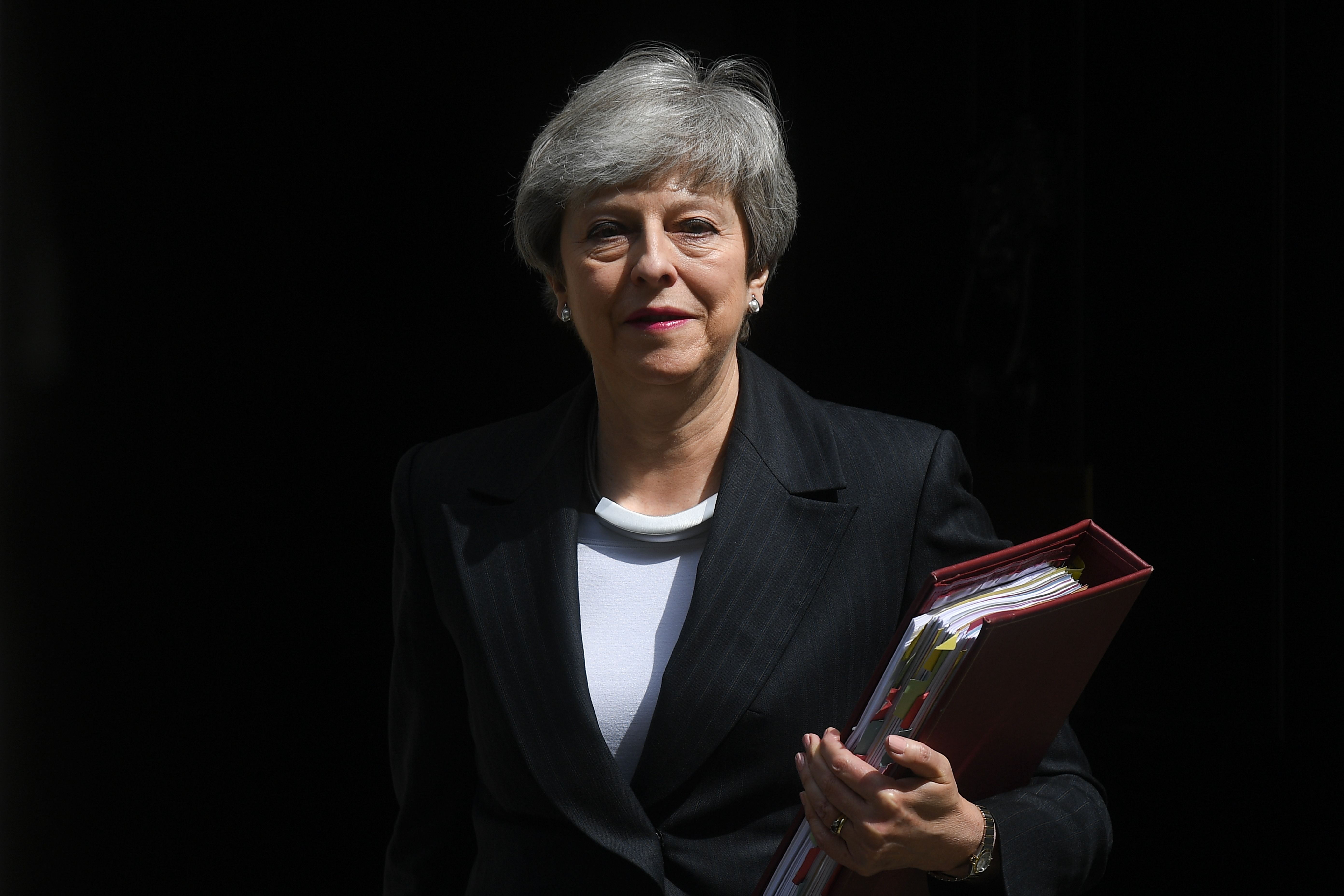 Theresa May leaves Downing Street for Prime Minister's Questions on Wednesday.