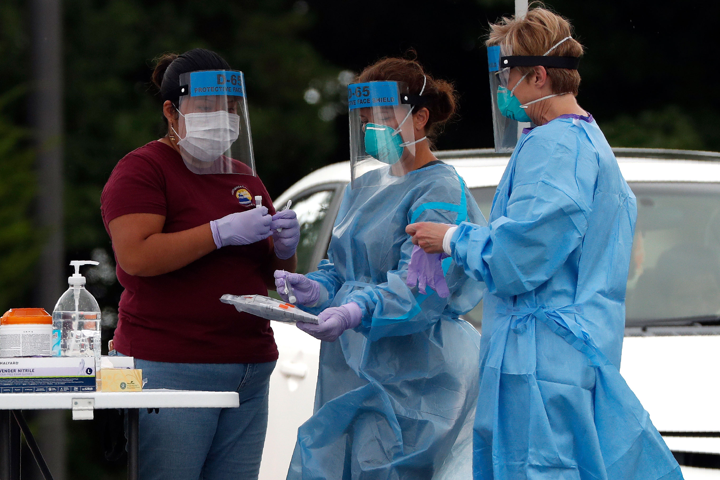 Medical personnel handle coronavirus test samples on July 9 in Burlington, North Carolina.