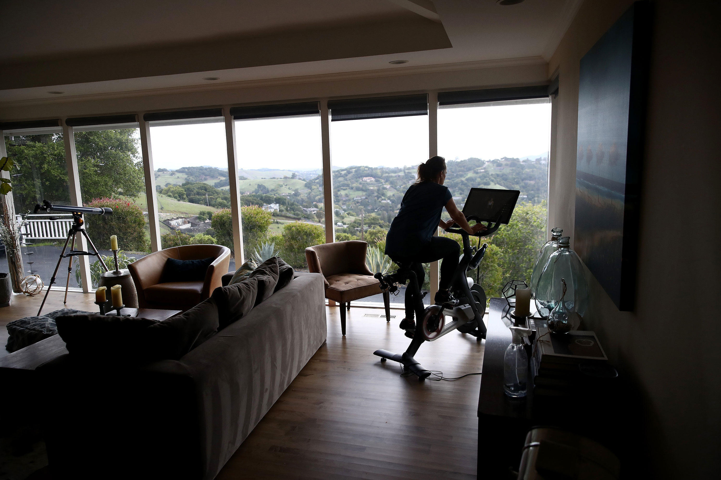 Becky Friese Rodskog rides her Peloton exercise bike at her home on April 6 in San Anselmo, California.