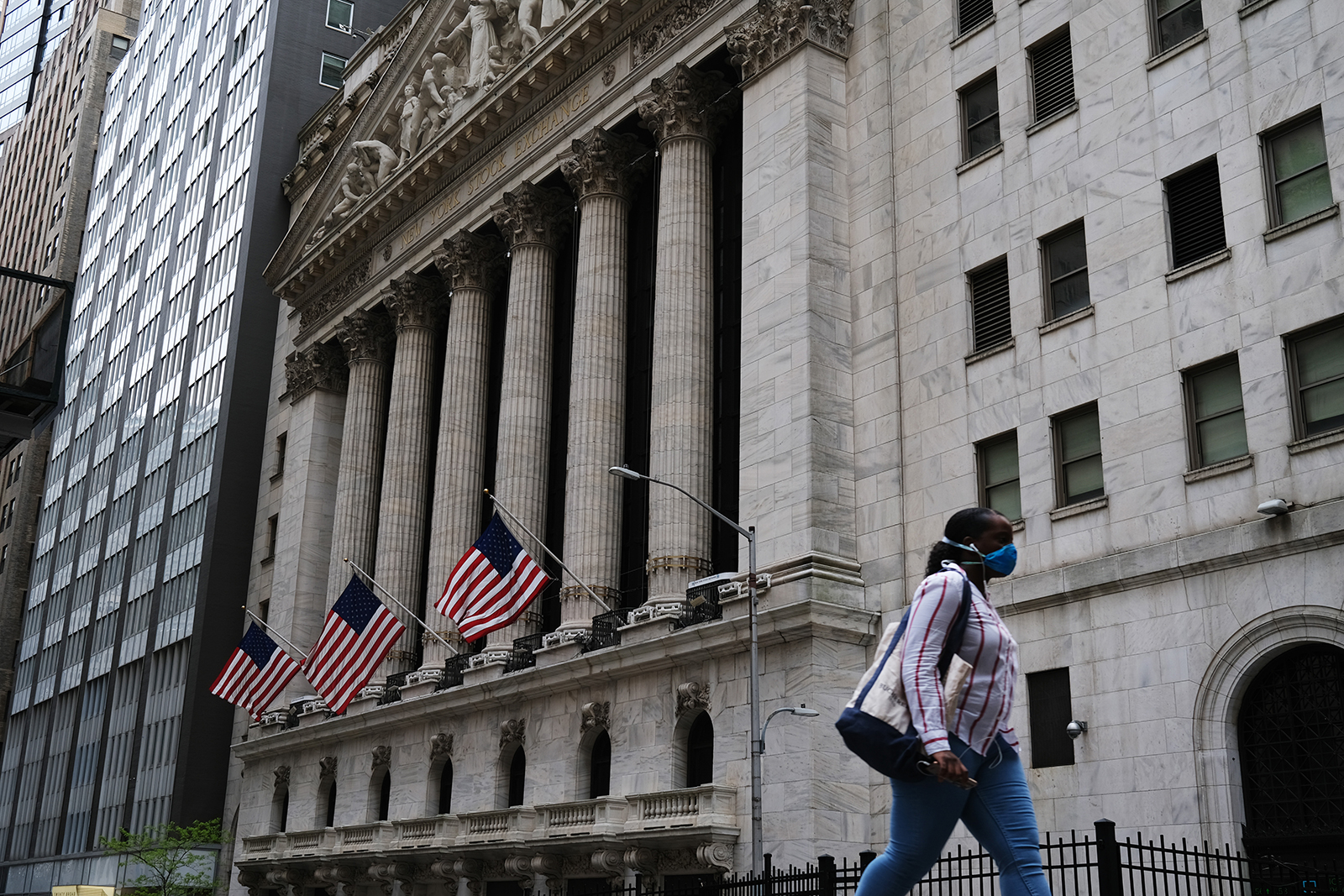 People walk by the New York Stock Exchange (NYSE) in New York City on May 18.