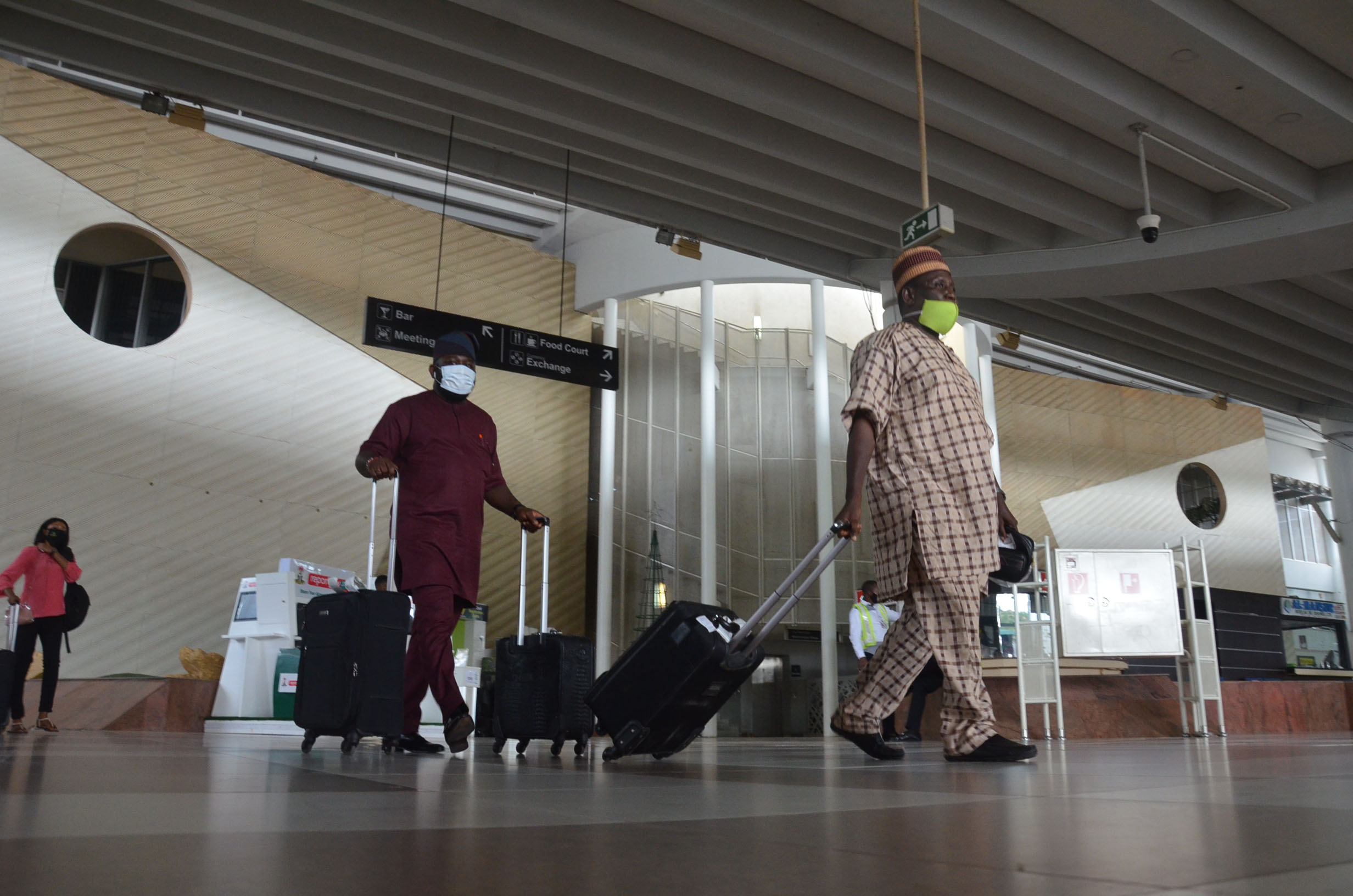 Passengers walk in the terminal building at the airport in Abuja, Nigeria, on July 8.