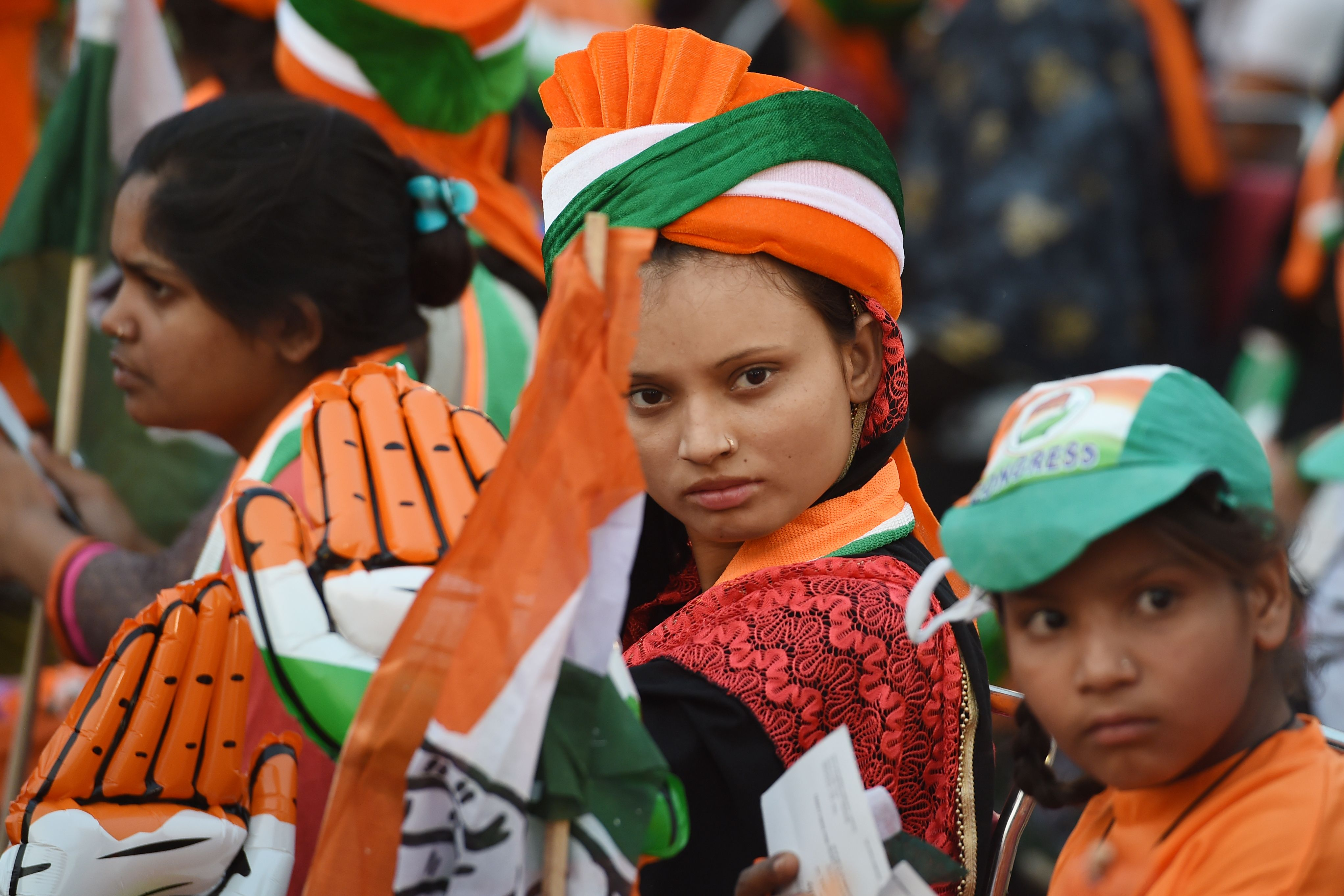 Indian supporters of Congress Party attend a rally addressed by Congress Party President Rahul Gandhi in New Delhi on May 9, 2019.