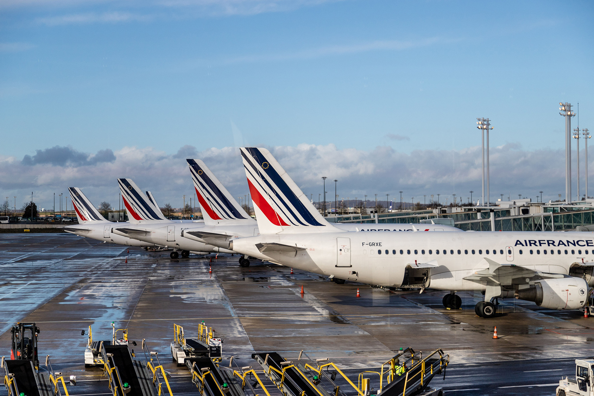Air France passenger aircraft stand on the tarmac at Charles de Gaulle airport in Roissy, France, on Tuesday, January 28.
