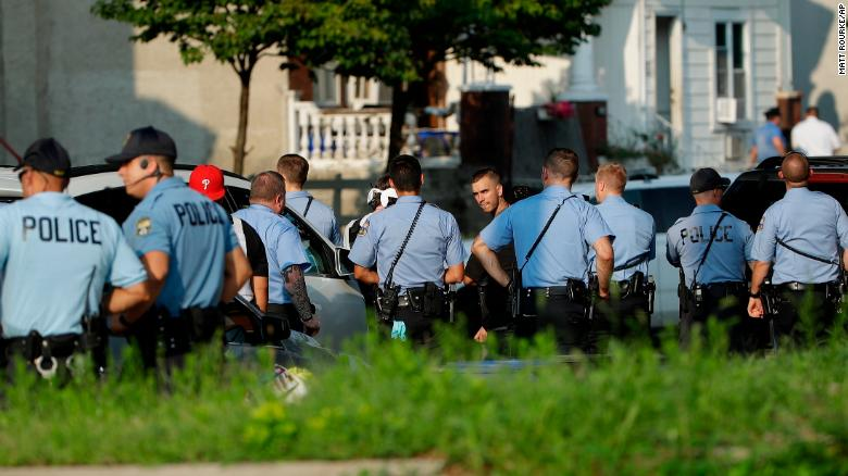 Authorities stage as they respond to an active shooting situation, Wednesday, Aug. 14, 2019, in the Nicetown neighborhood of Philadelphia.