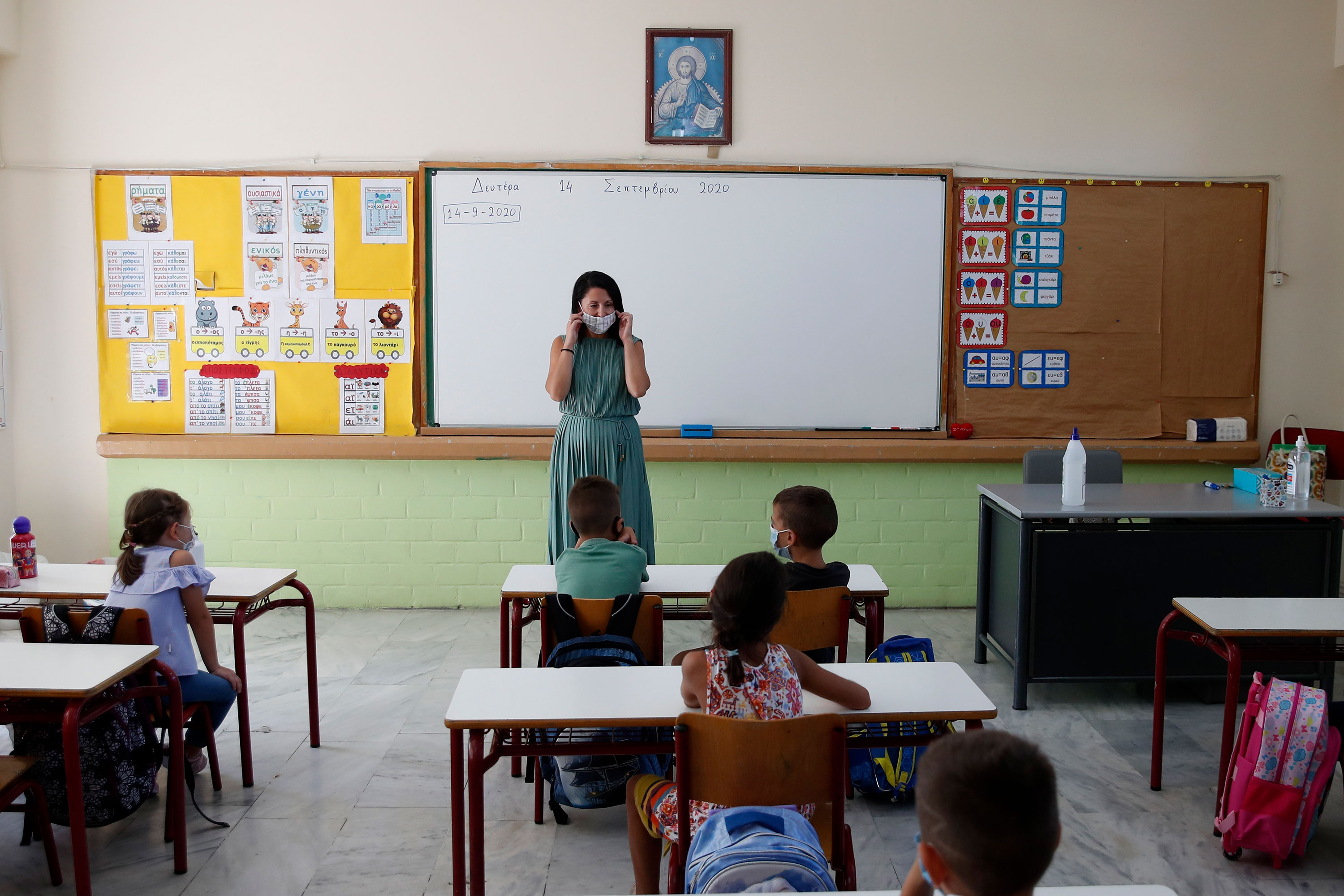 A teacher explains to students how to use the face masks at a primary school in Athens, Greece, on September 14.