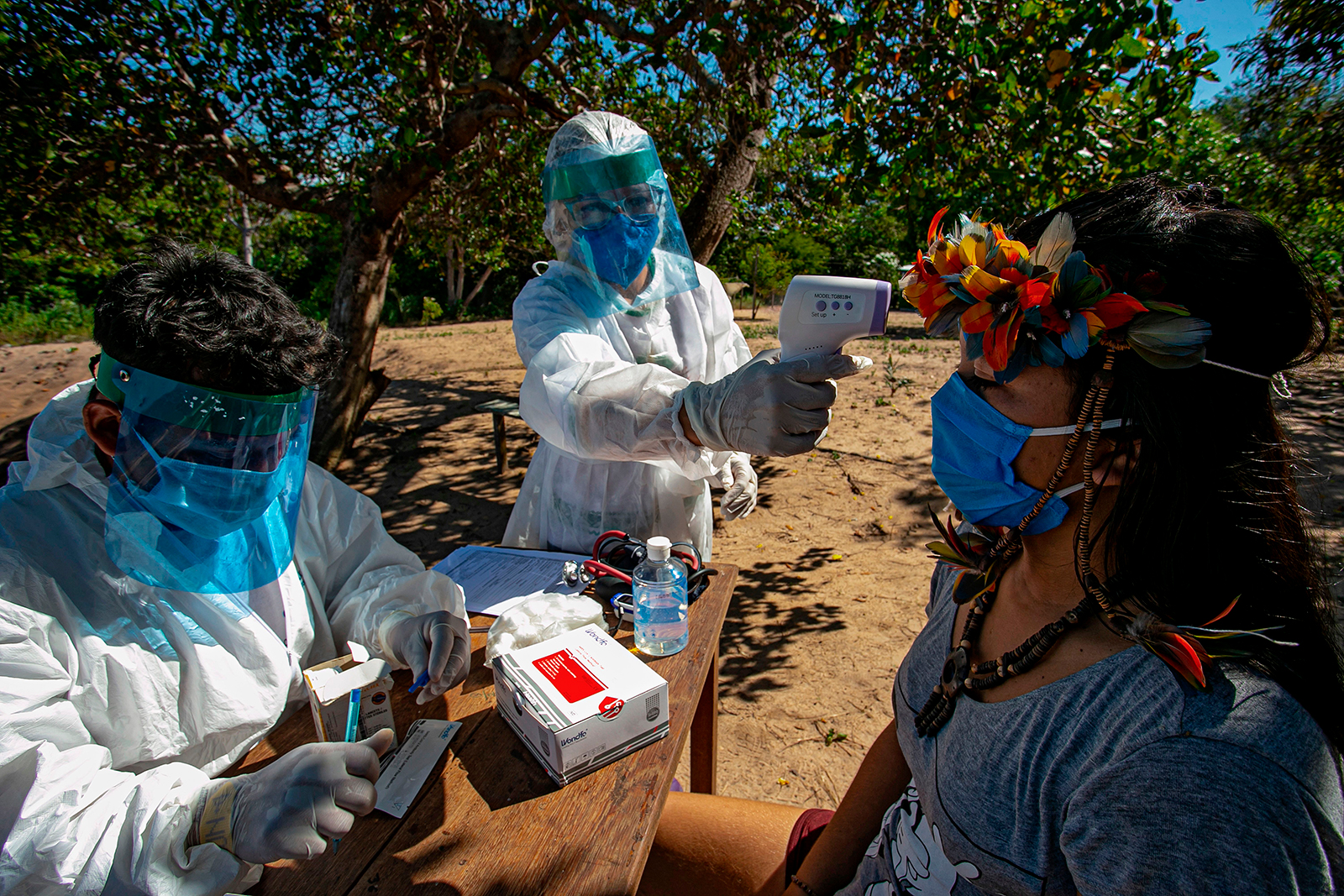 Indigenous nurses from the Special Secretariat for Indigenous Health (Sesai) of the Arapiuns ethnic group and Tapuia ethnic groups perform rapid COVID-19 testing on the banks of the lower Tapajos River in the municipality of Santarem in western Para on Sunday, July 19.