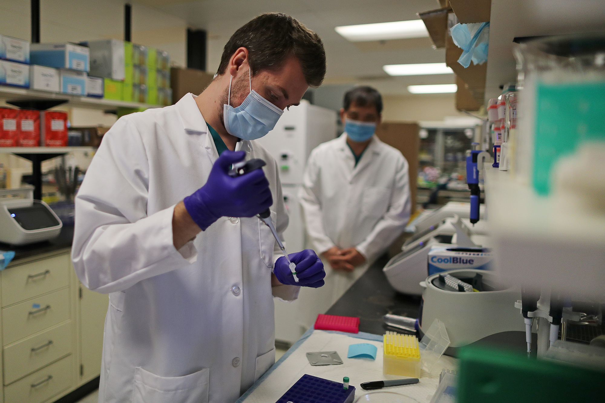 In this August 5 file photo, a lab technician prepares a solution that will be used to process coronavirus test samples at Advagenix, a molecular diagnostics laboratory, in Rockville, Maryland.